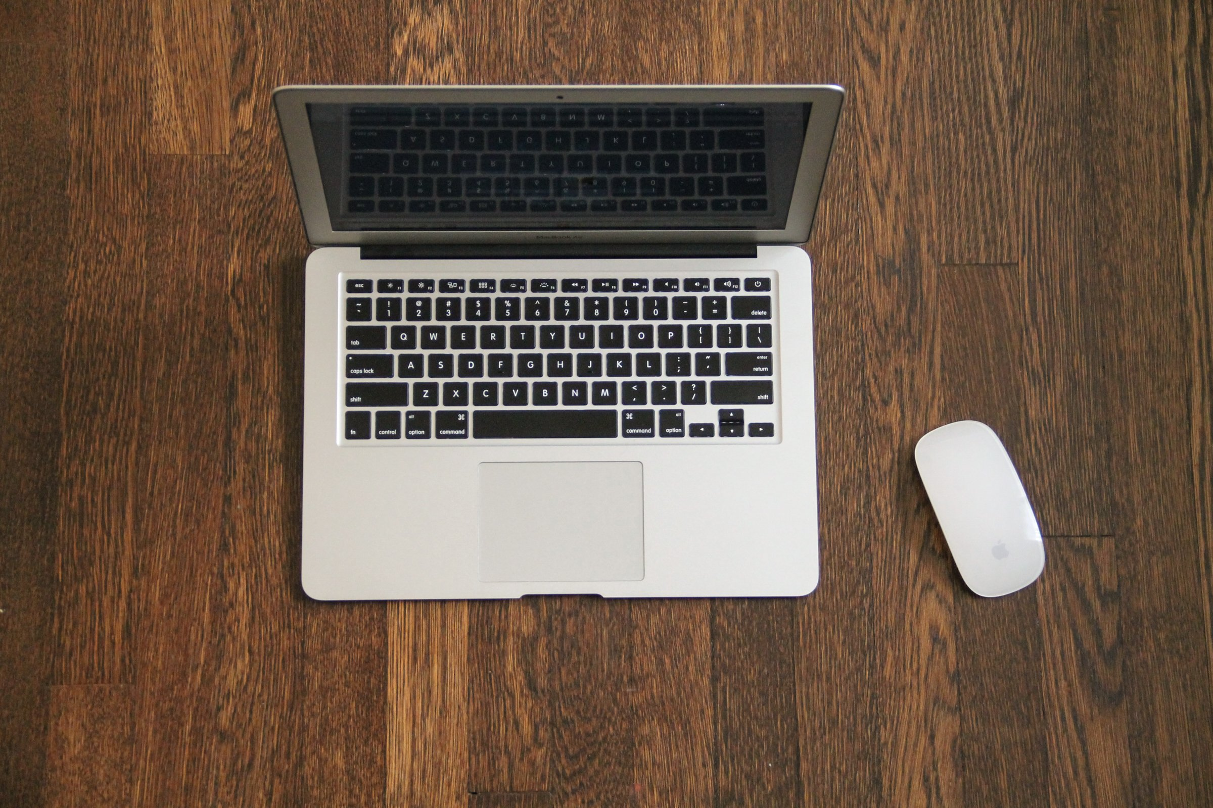 Macbook Air & Mouse on Wooden Desk » Good Stock Photos