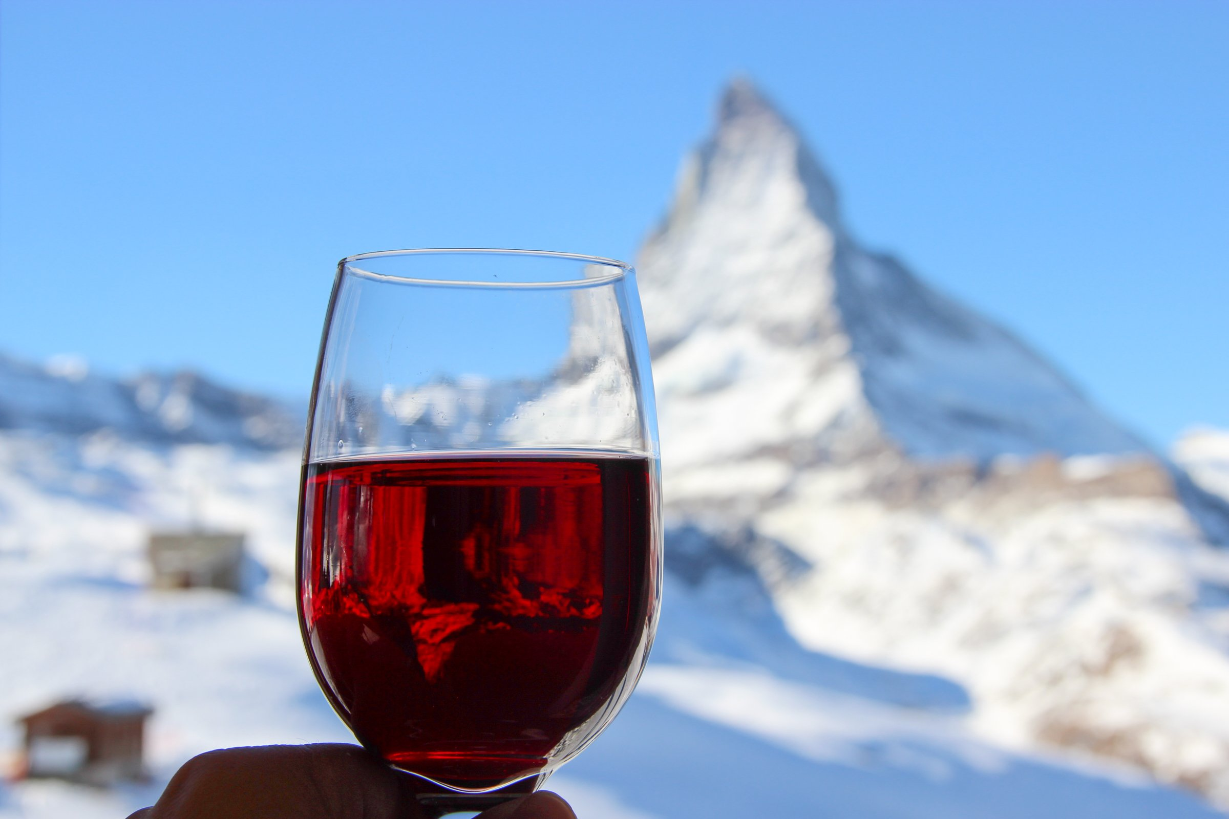 193cb088b402 Free Stock Photo of Glass of Red Wine with Snowy Mountain in Background