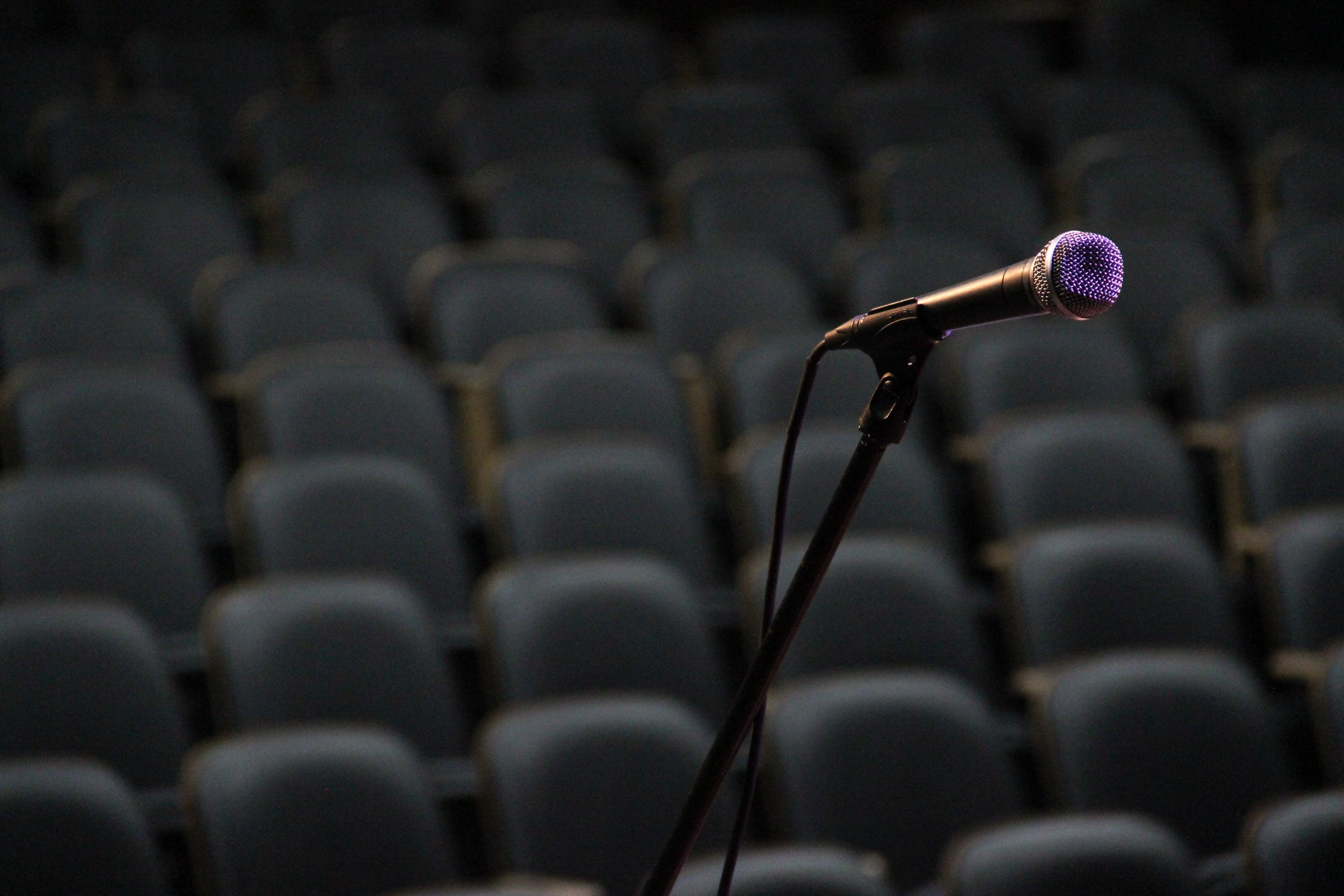 Microphone on Stand in Front of Empty Chairs