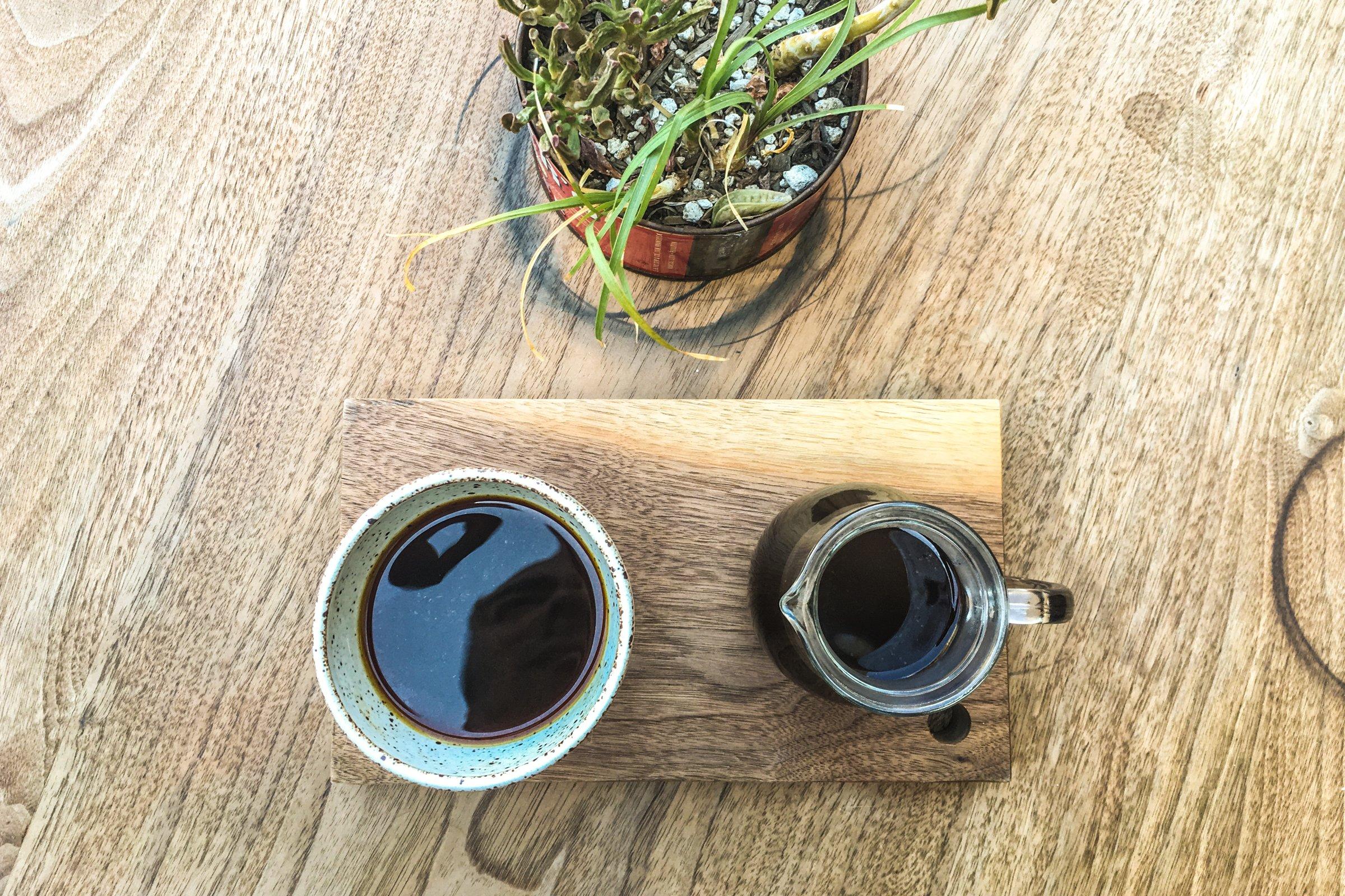 Coffee Cup & Mug on Wood Table