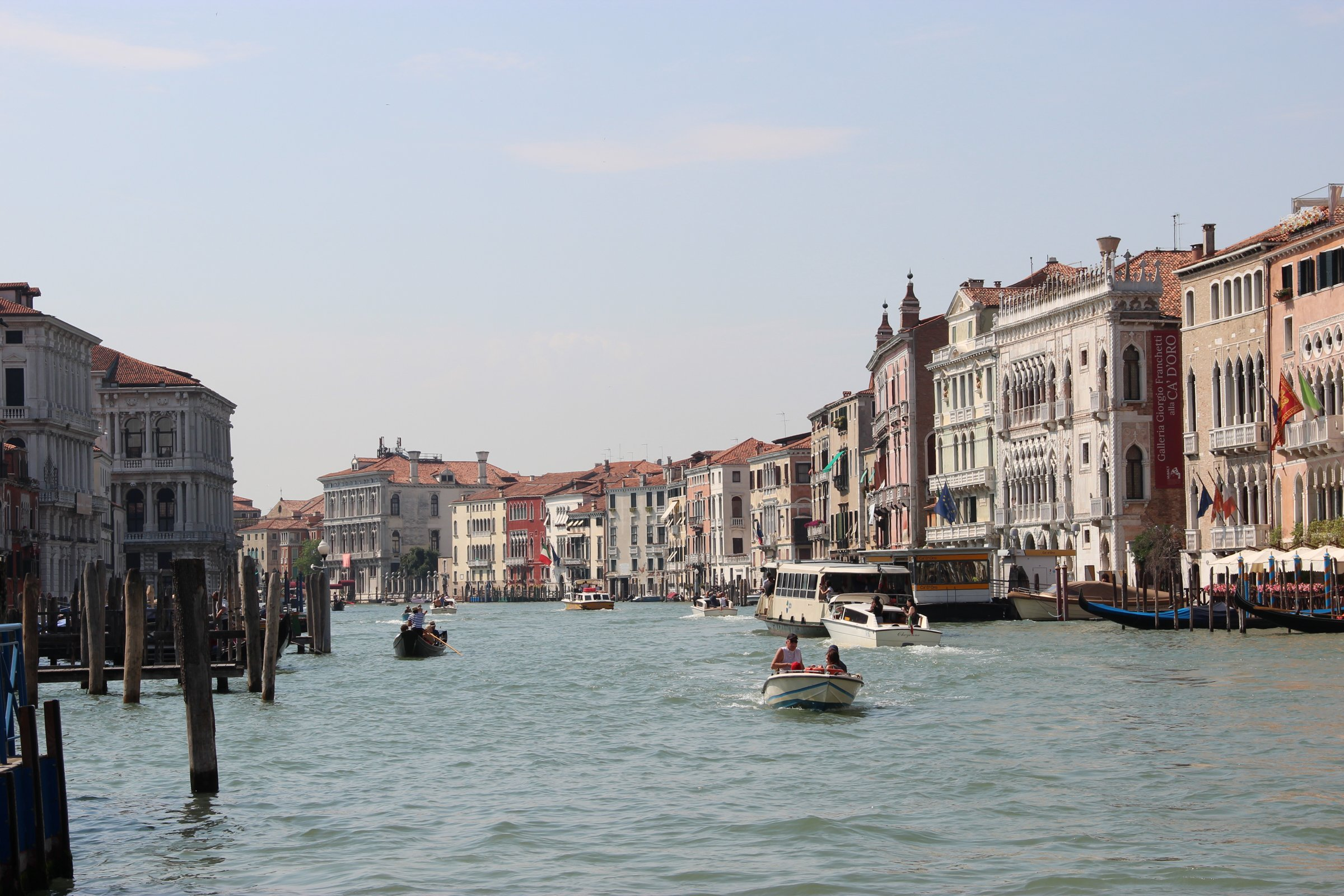 Boats on Venice Canals with Buildings