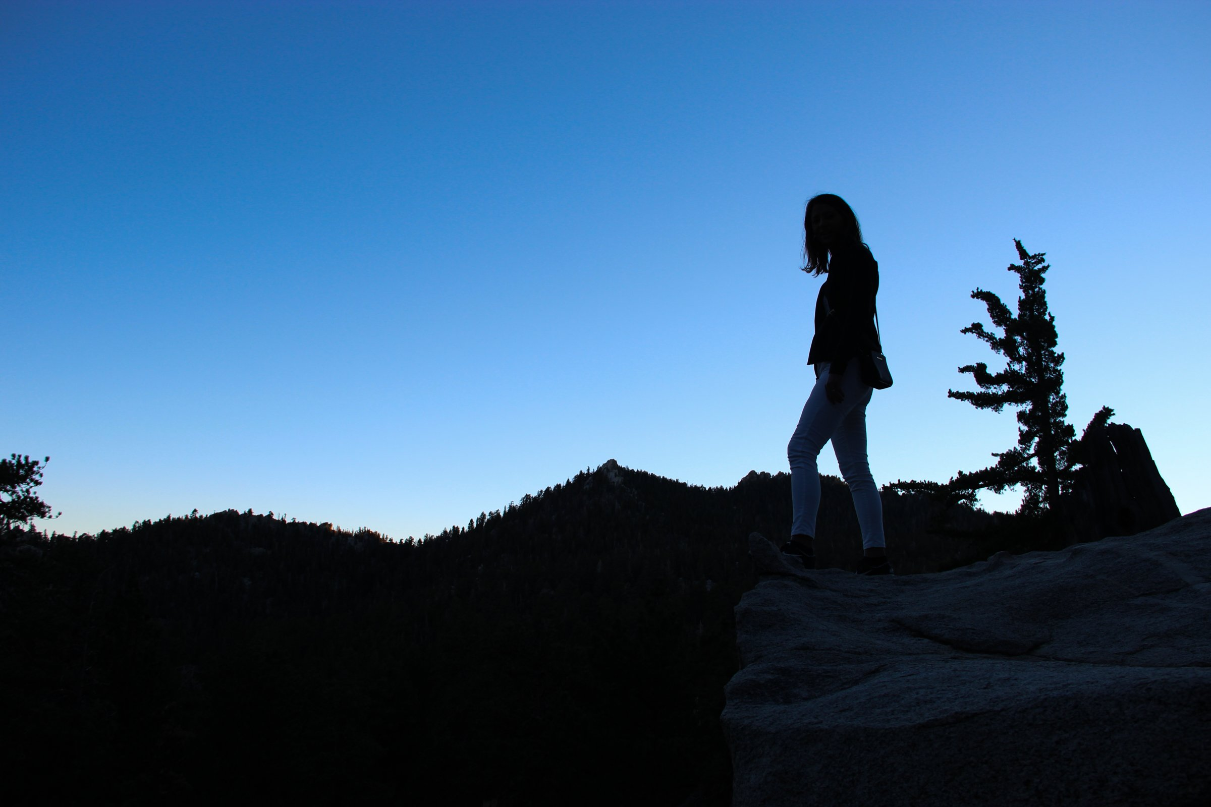 Silhouette of Woman Standing on Mountain
