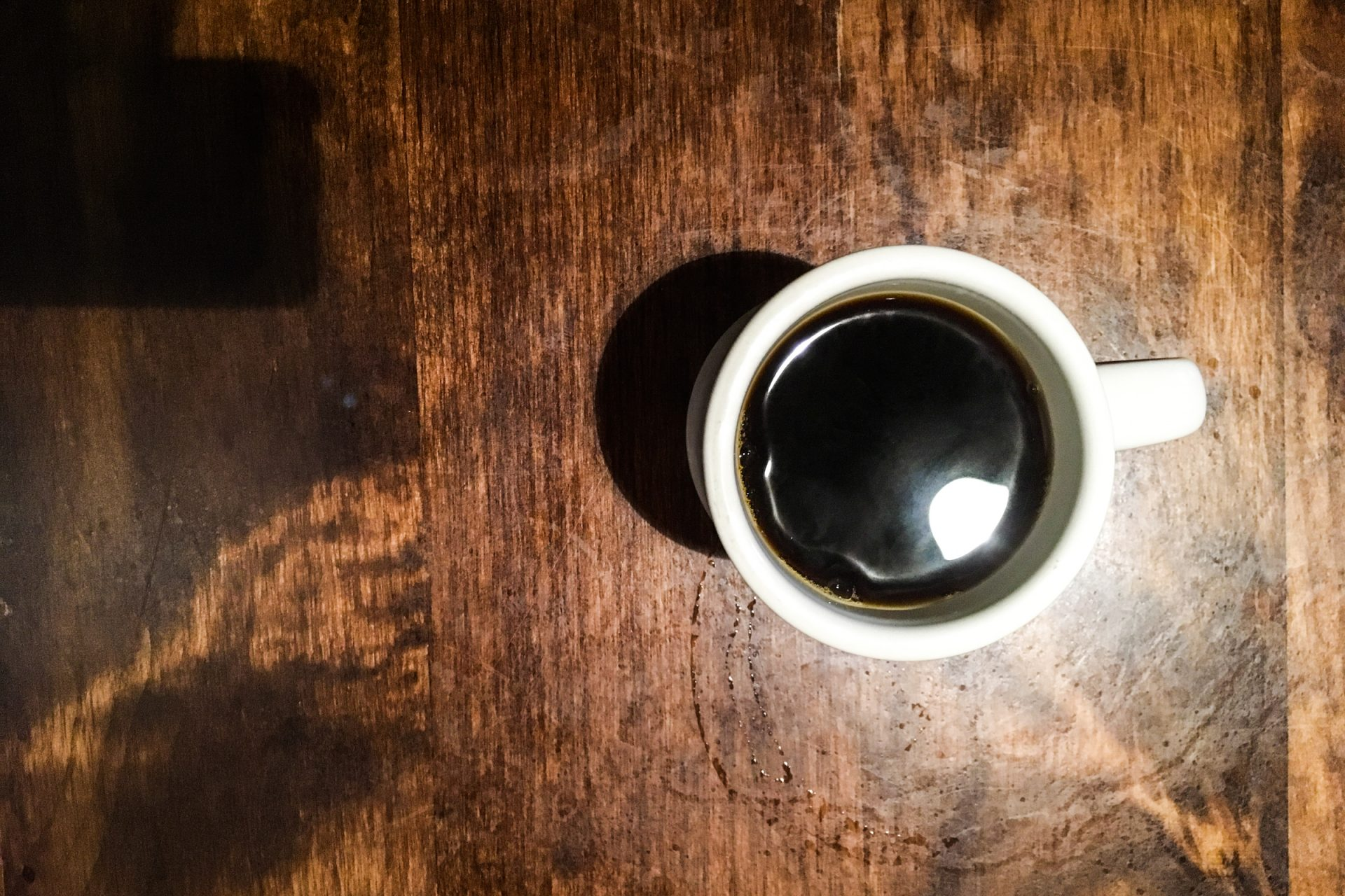 White Cup of Coffee on Wood Table