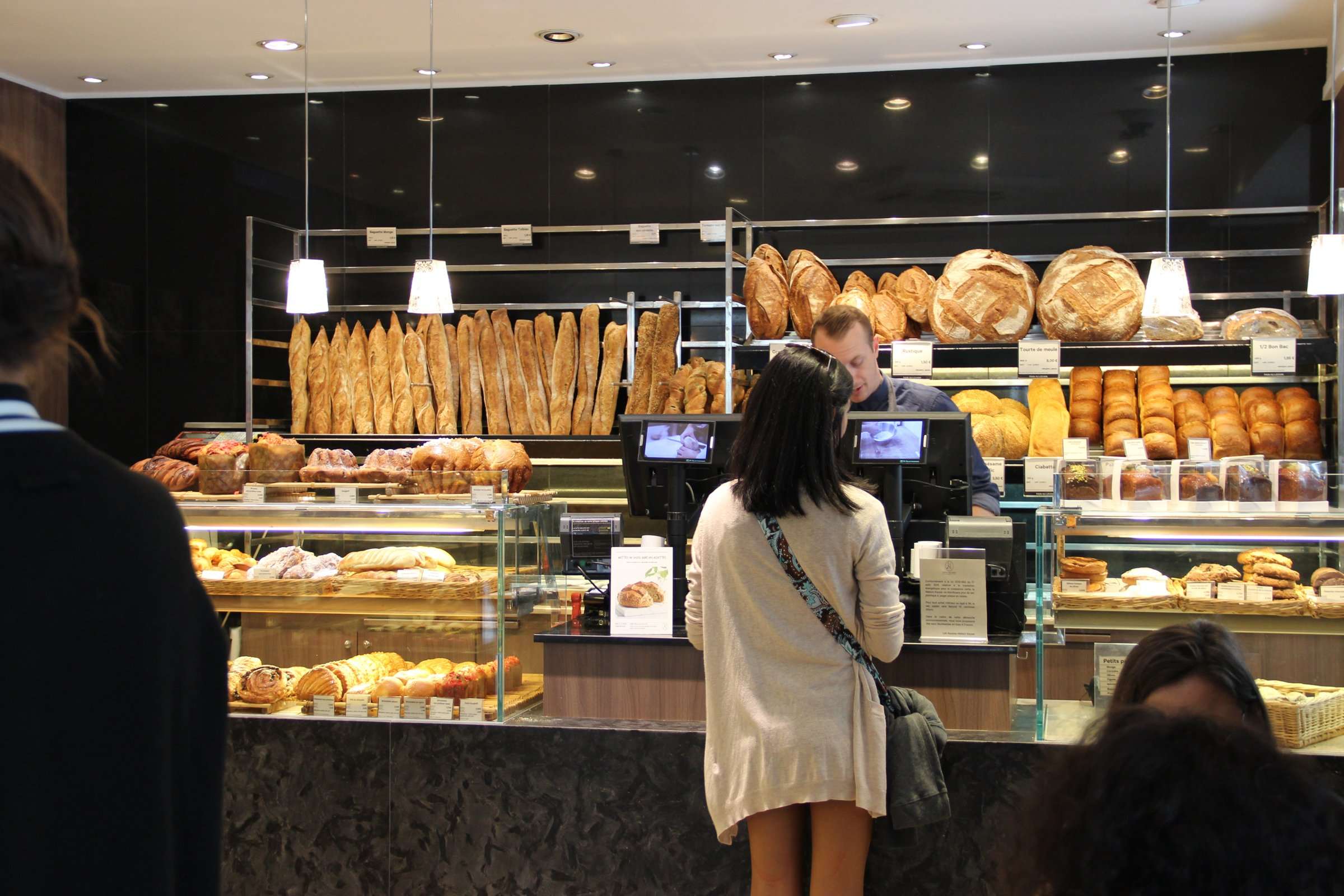 Woman Standing at Checkout in Bakery