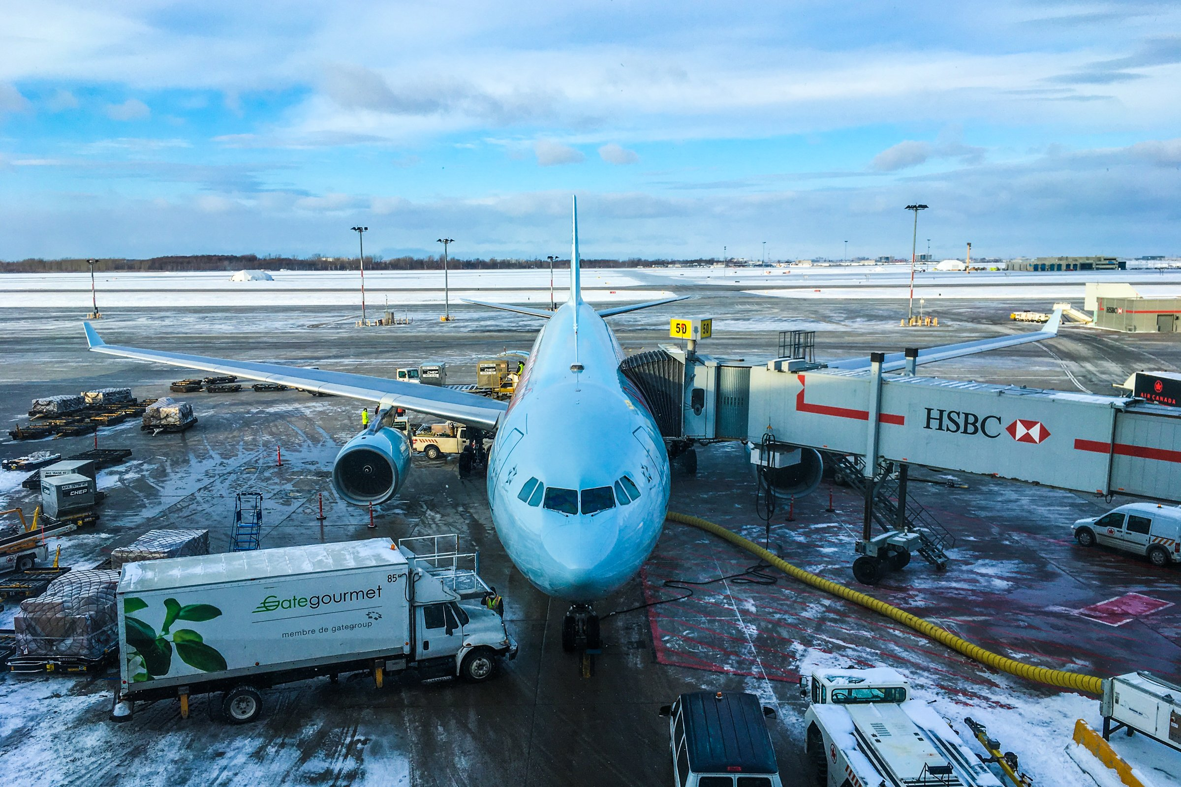 Airplane at Snowy Airport Terminal