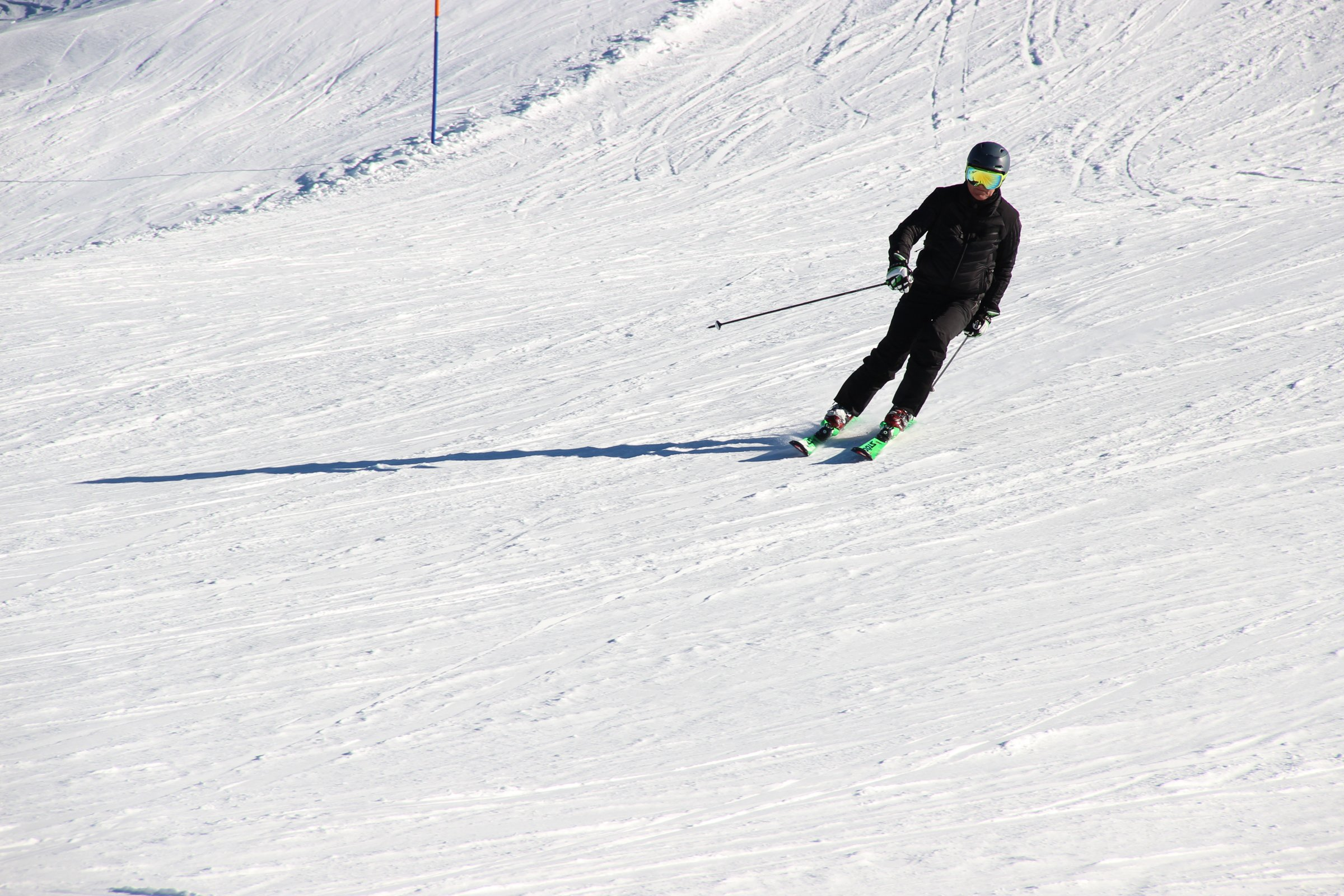 Man Skiing Down Snow Slope