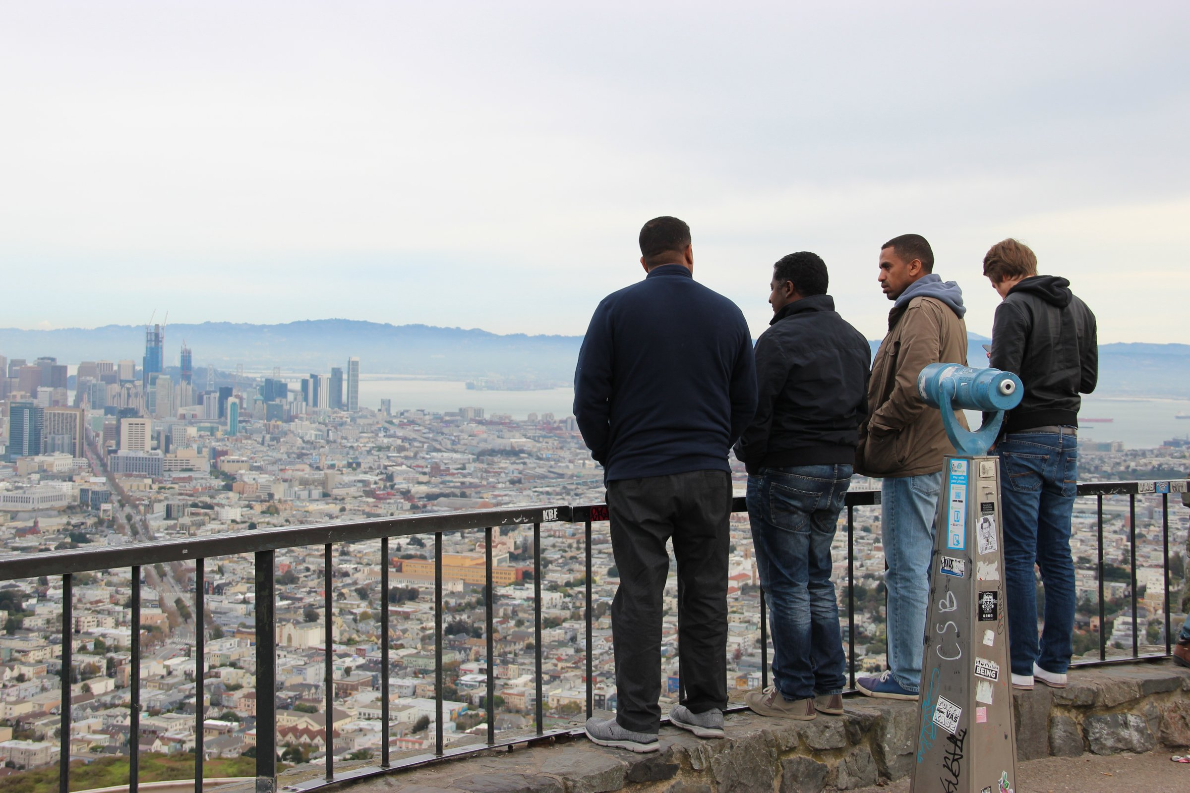 Men Looking Out Over City