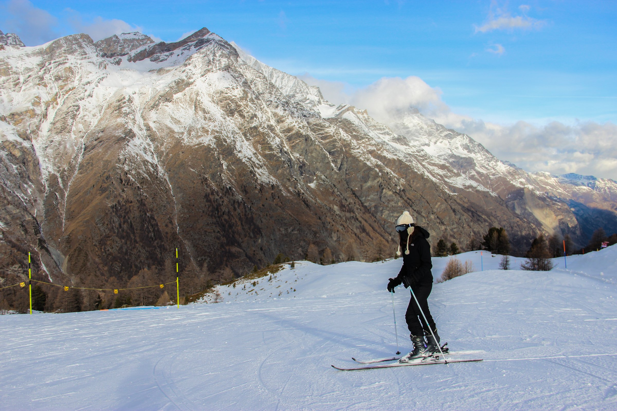 Skier in Front of Mountain Range