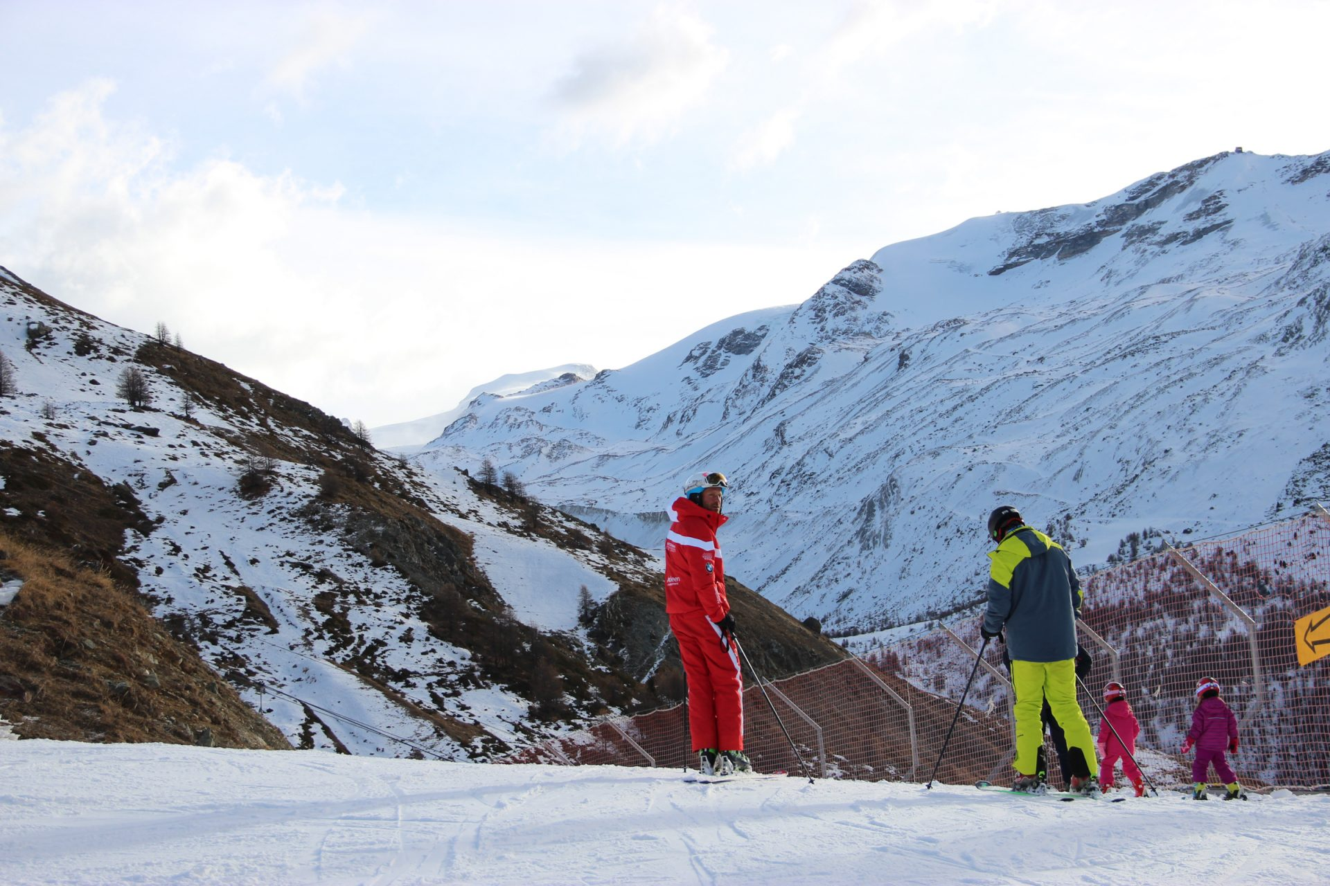 Skiers Standing on Mountain Slope
