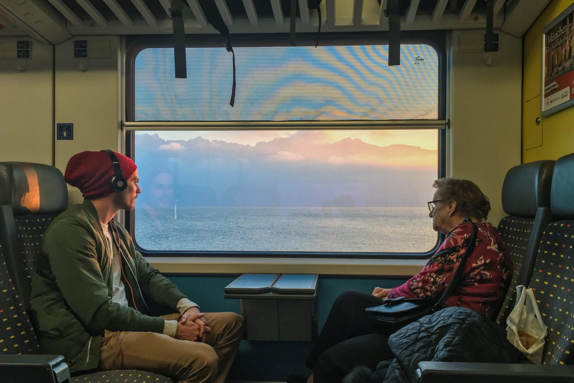 Young Man & Elderly Woman on Train