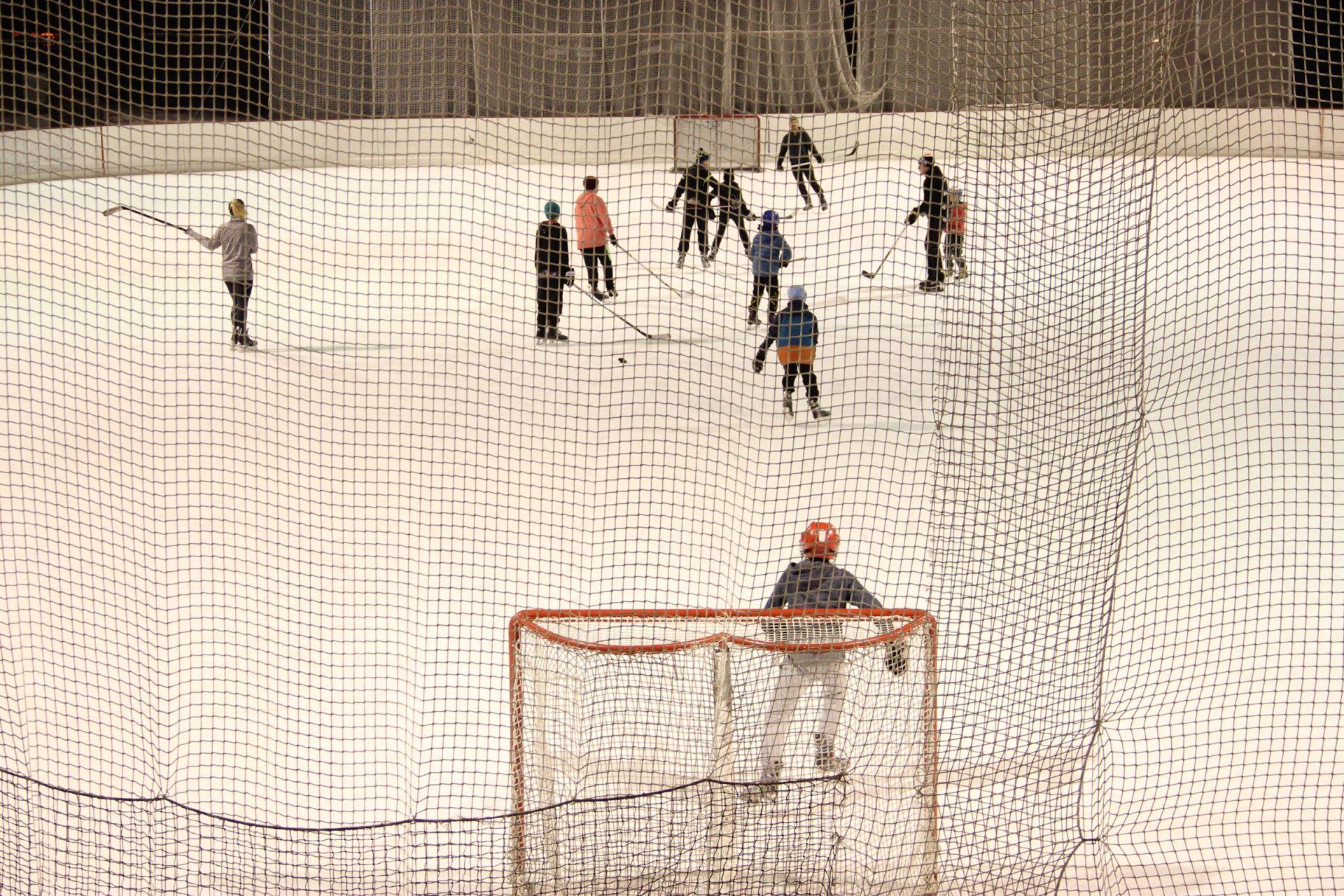 Kids Playing Hockey in Rink