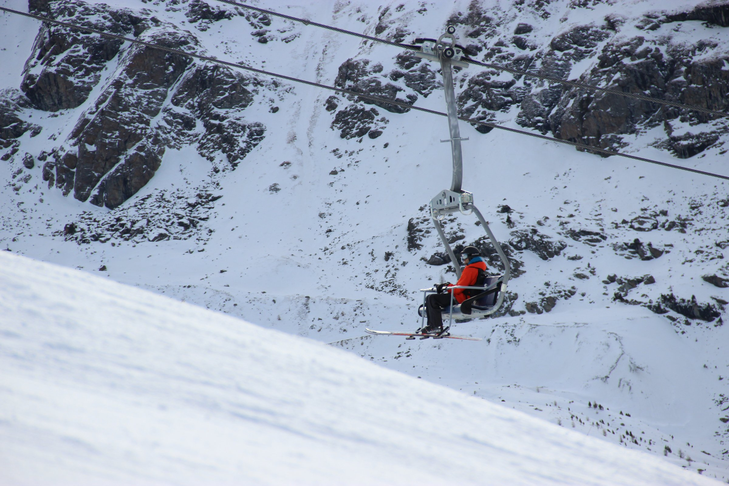 Man Riding on Ski Lift