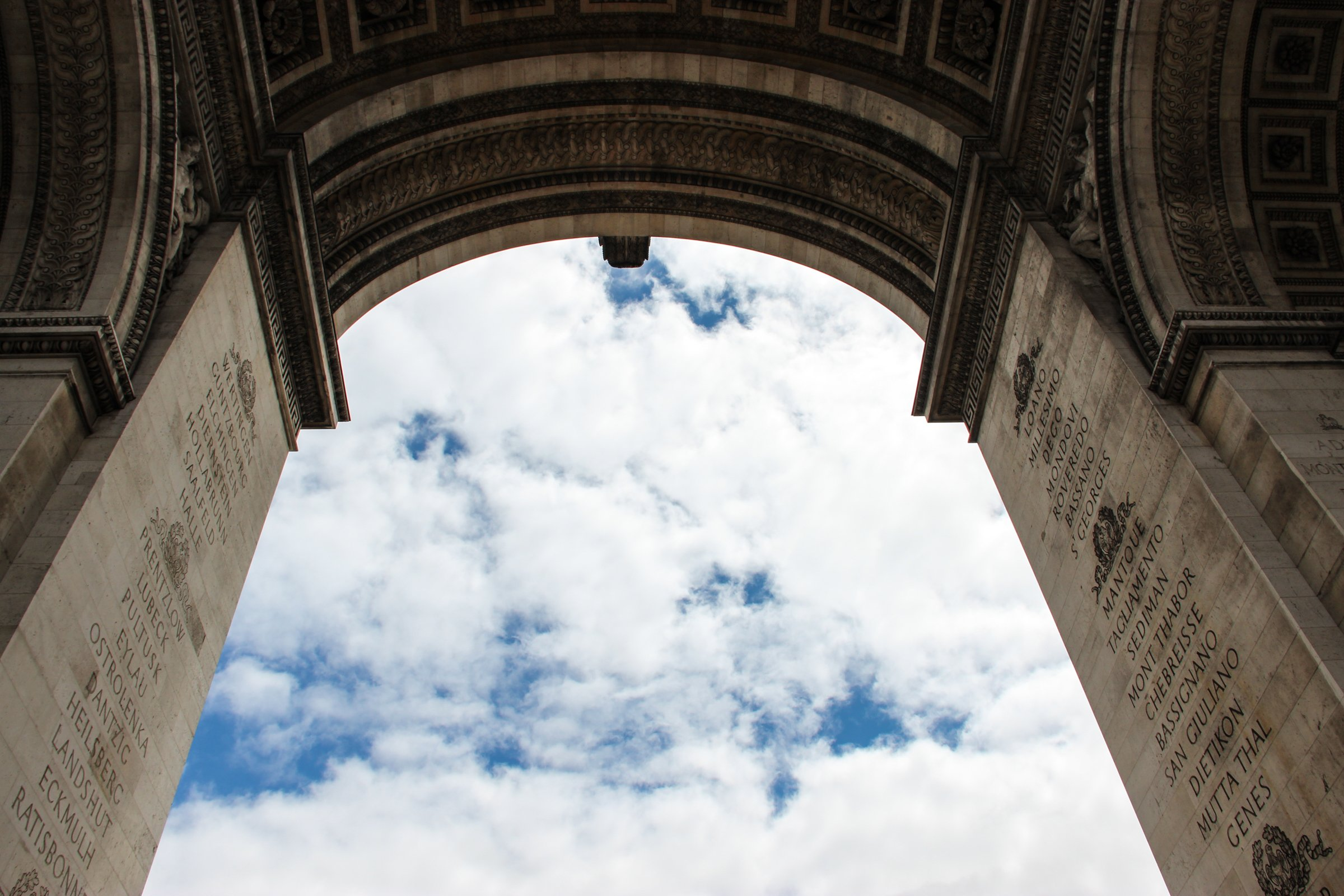 Building Archway Under Clouds