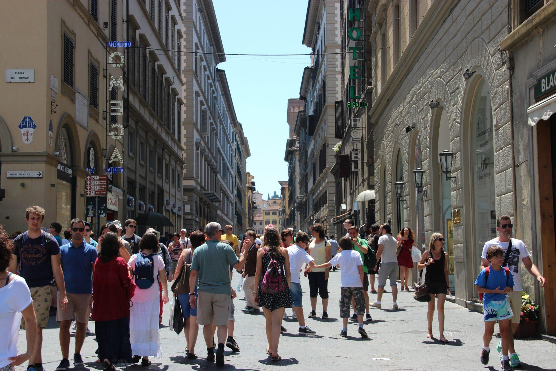 Crowds of People Walking on Street
