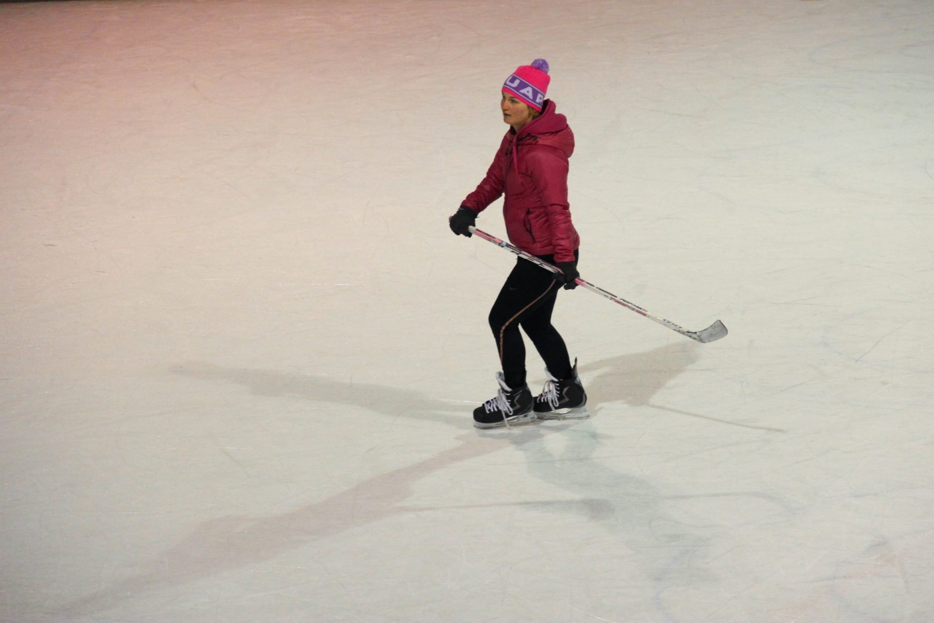 Girl with Hockey Stick on Ice