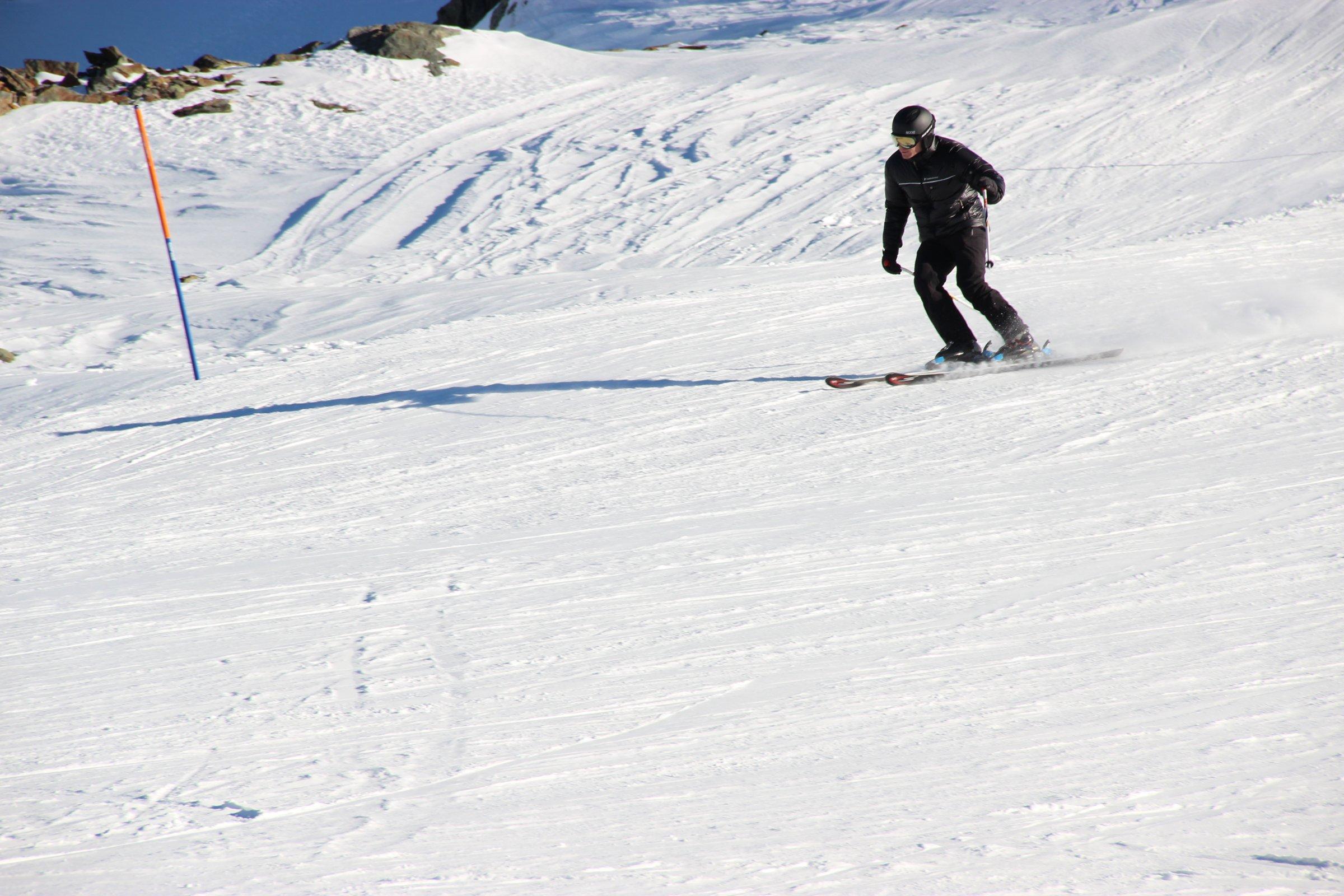 Man Skiing Down Snow Slopes