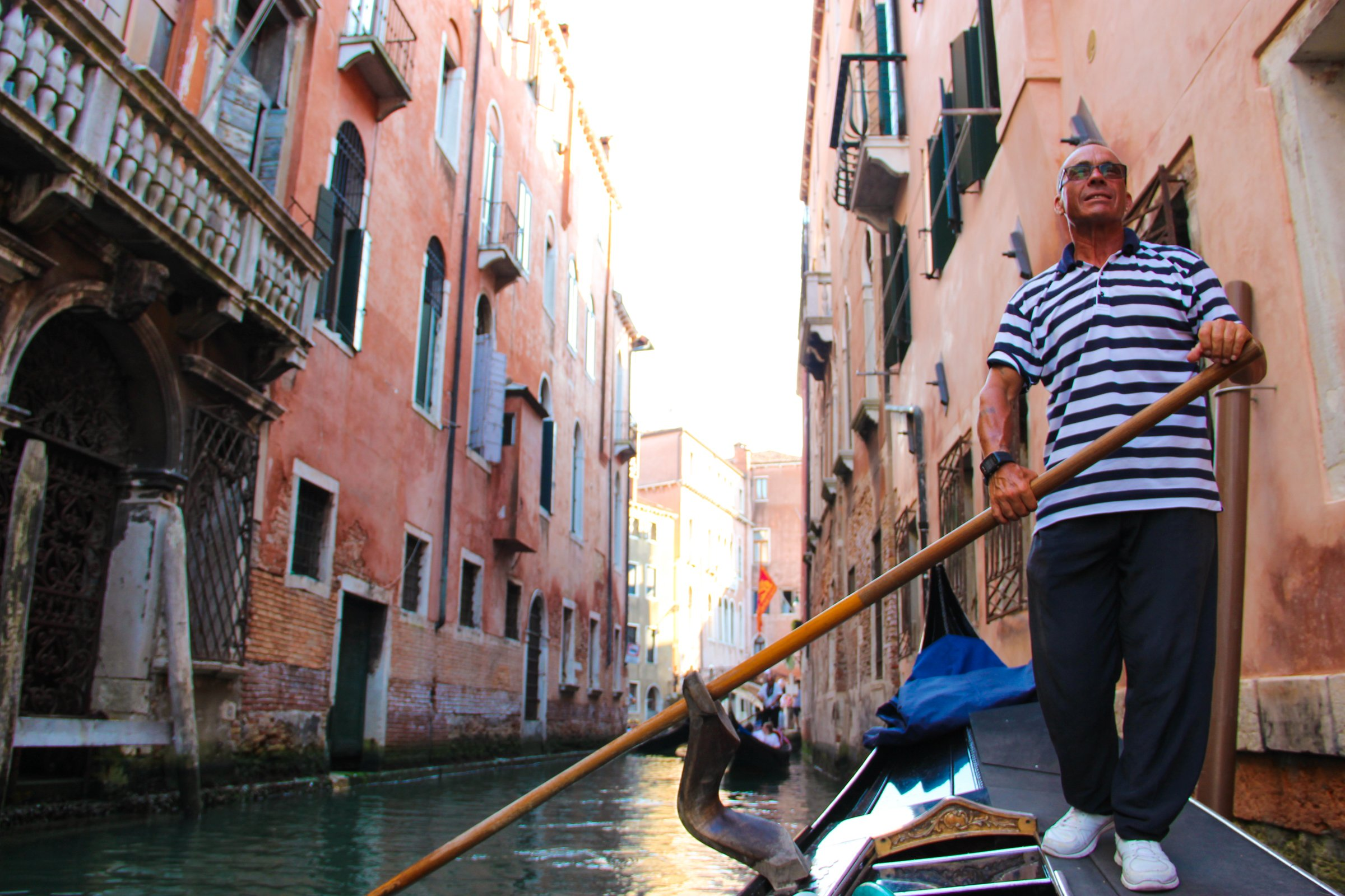 Man Rowing Gondola Through Canals