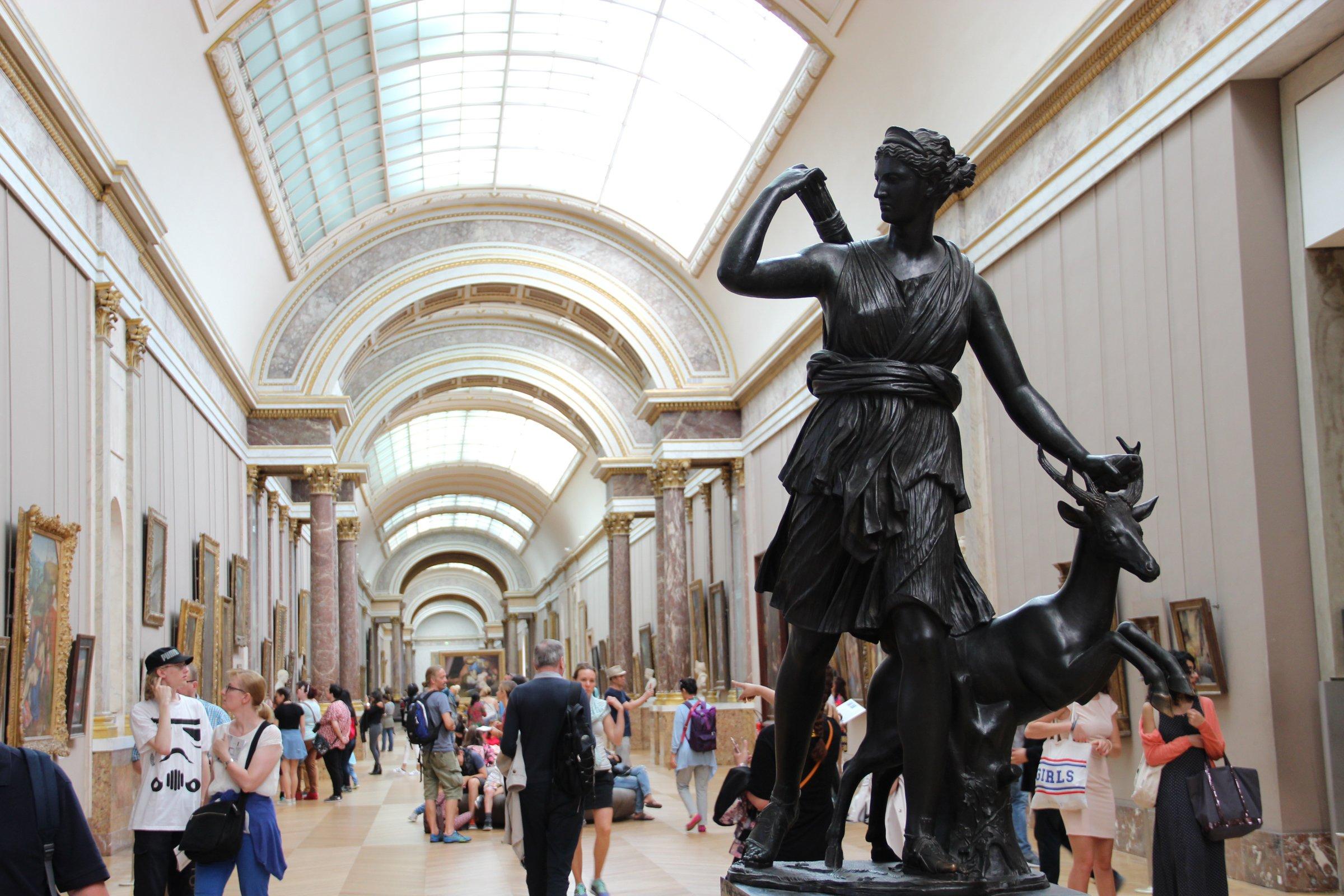 Statue in Museum Hallway