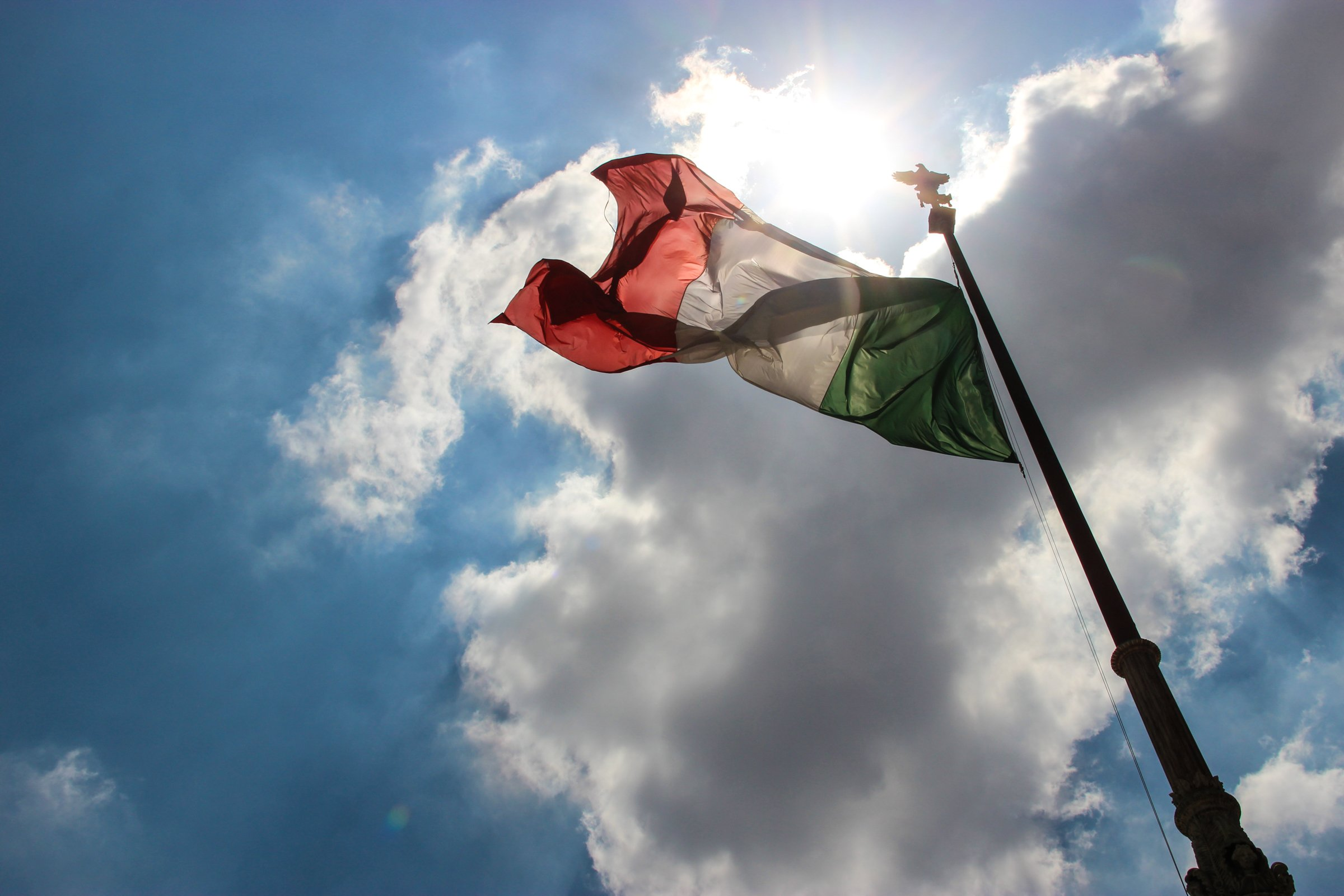Italian Flag Under Sun & Clouds