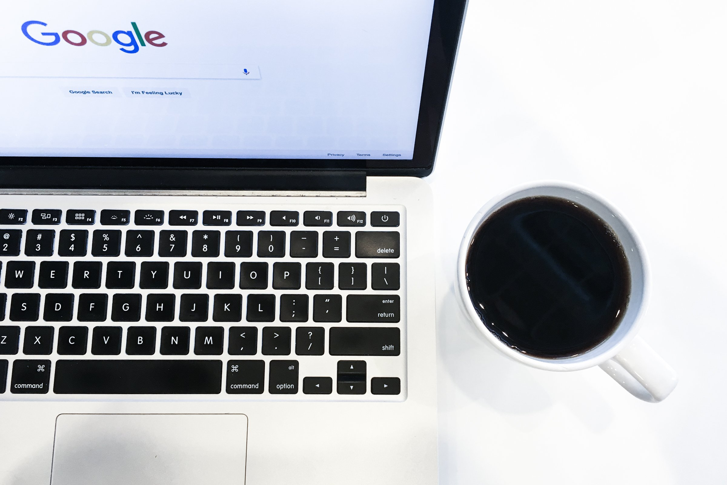 Free Stock Photo of Laptop Next to Coffee Cup