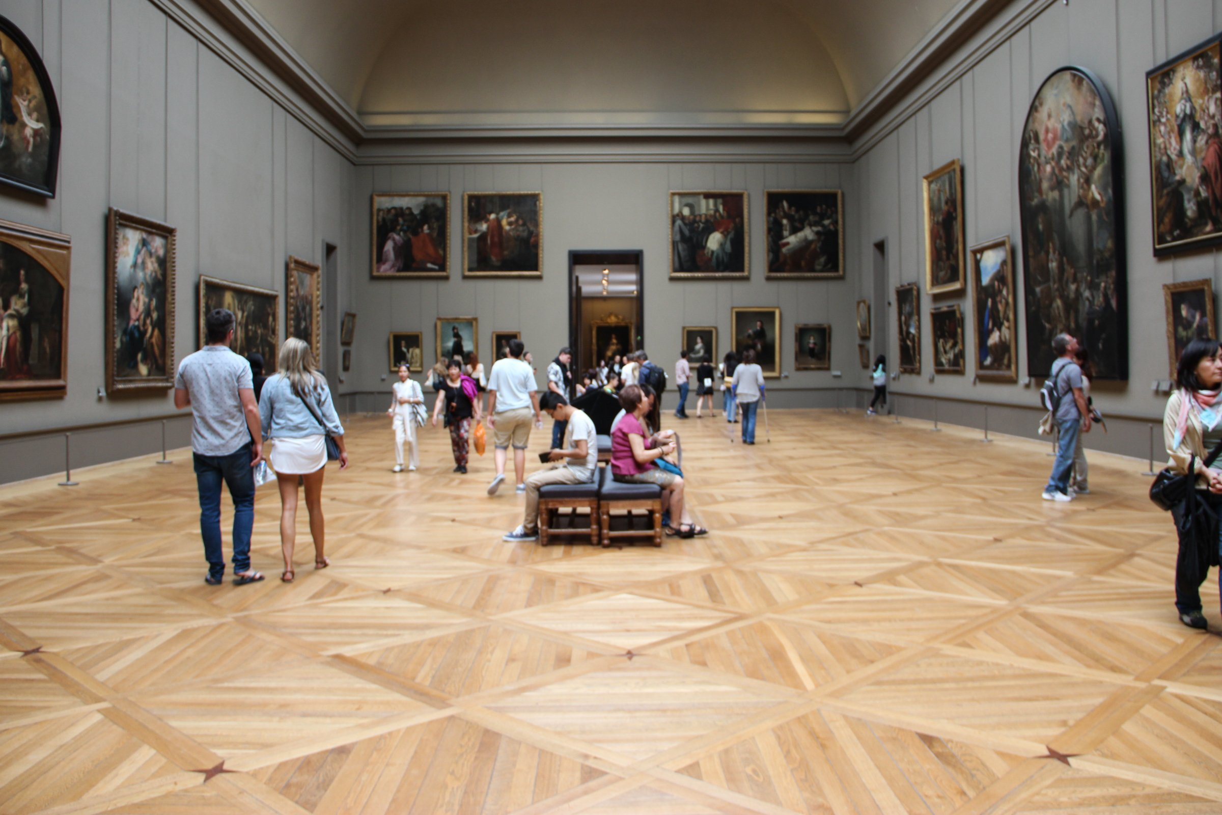 Free Stock Photo of People in Museum Room with Paintings