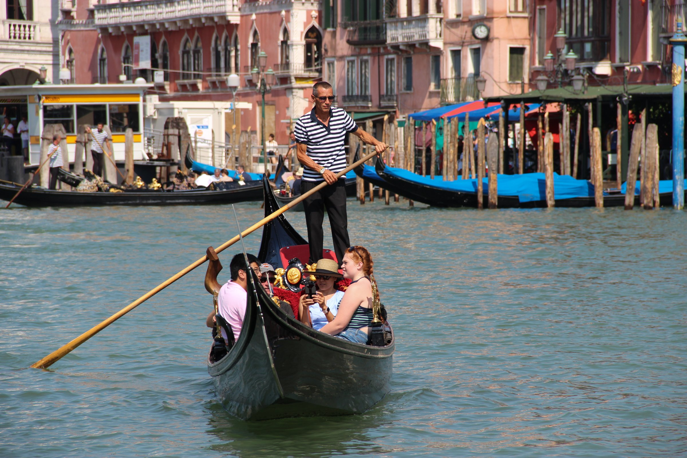 Man Rowing with Tourists in Gondola
