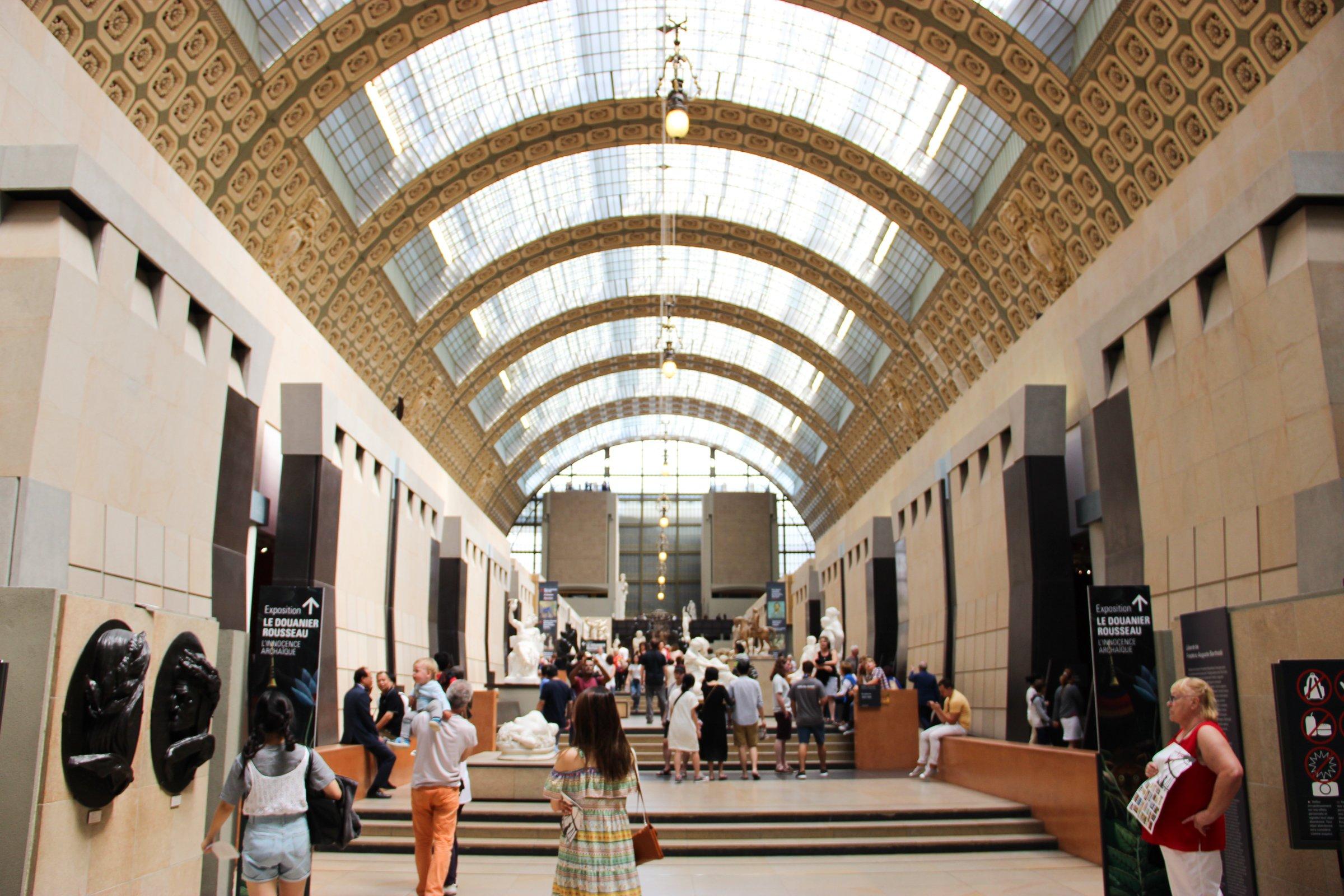 People in Hallway of Museum