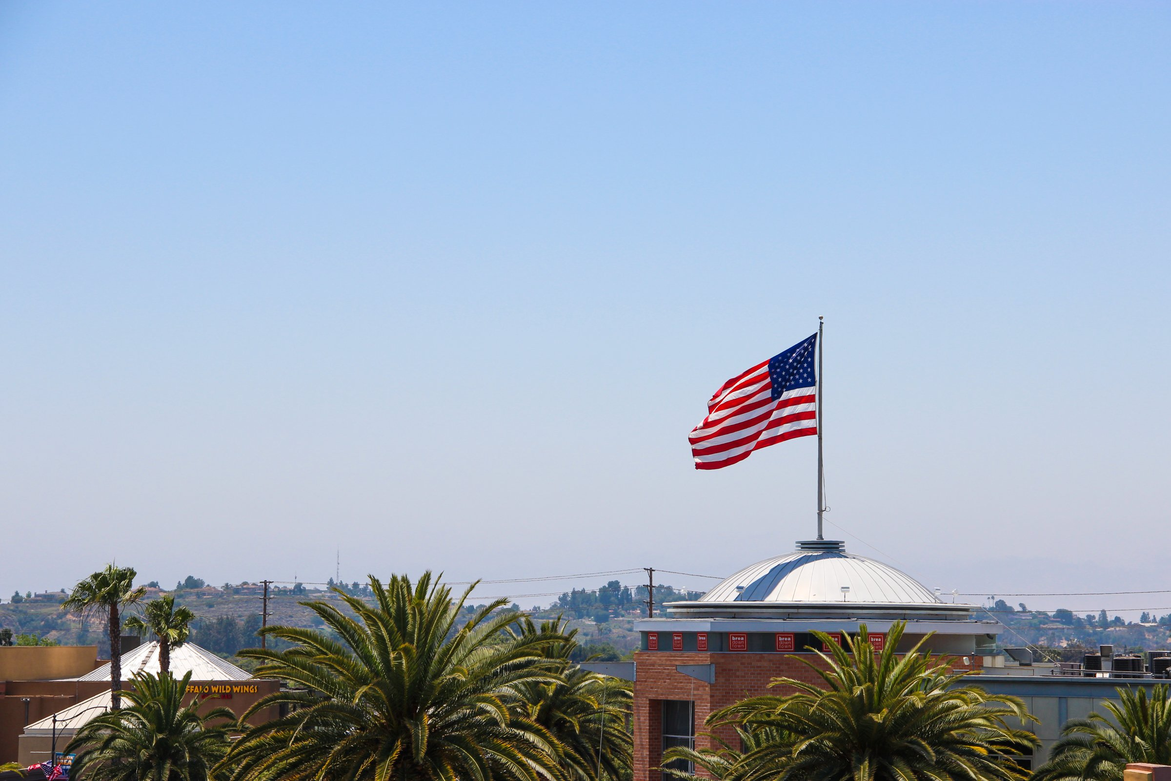 American Flag & Building Rooftops