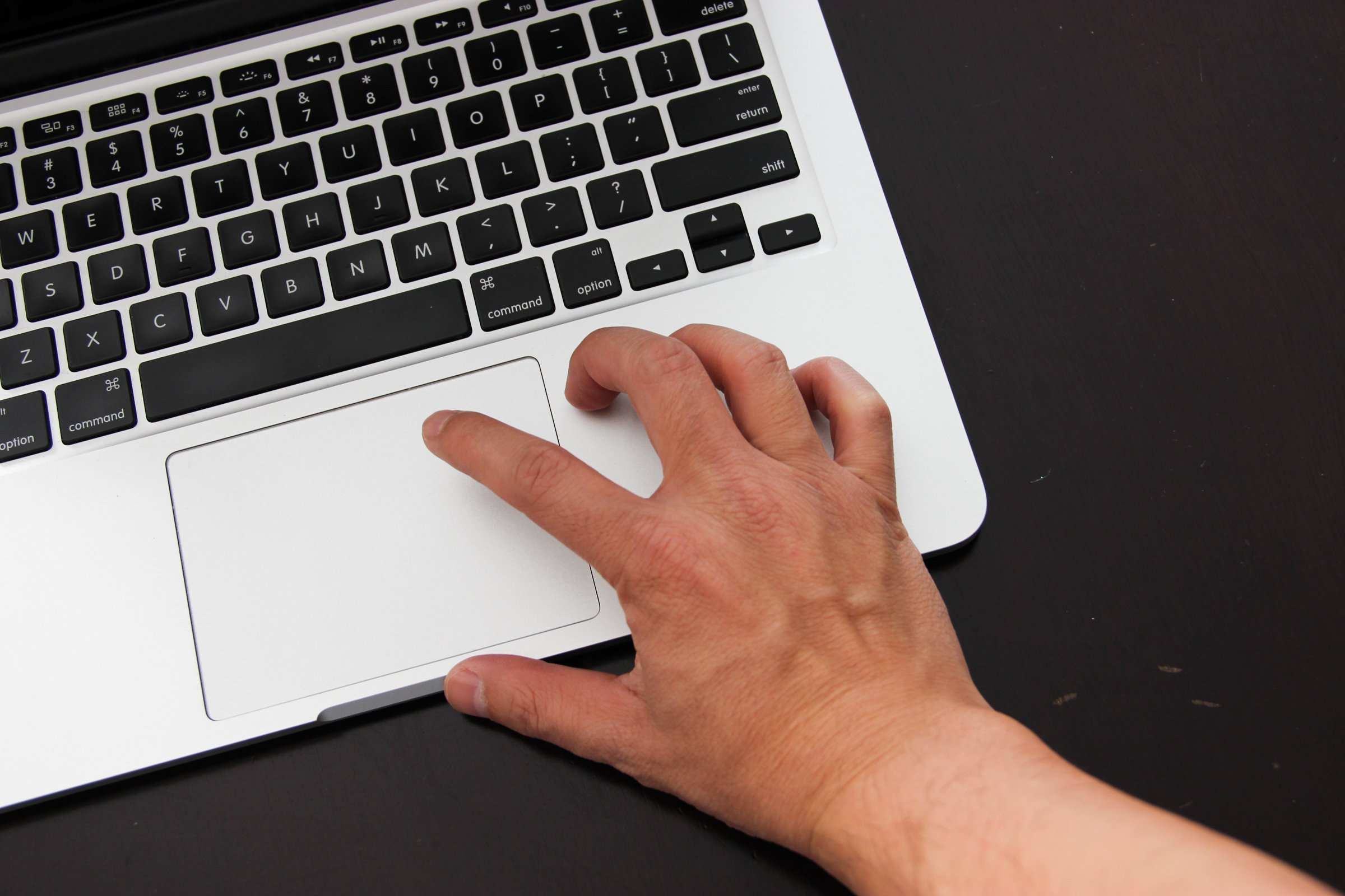 Hand Clicking on Laptop