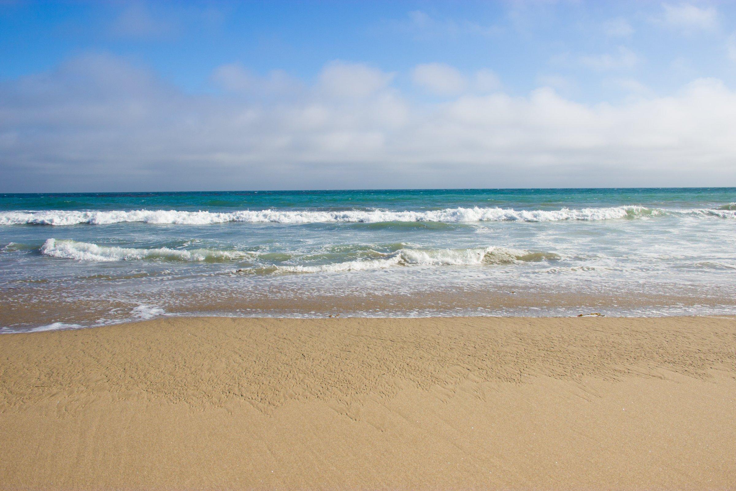 Ocean Waves on Beach Sand