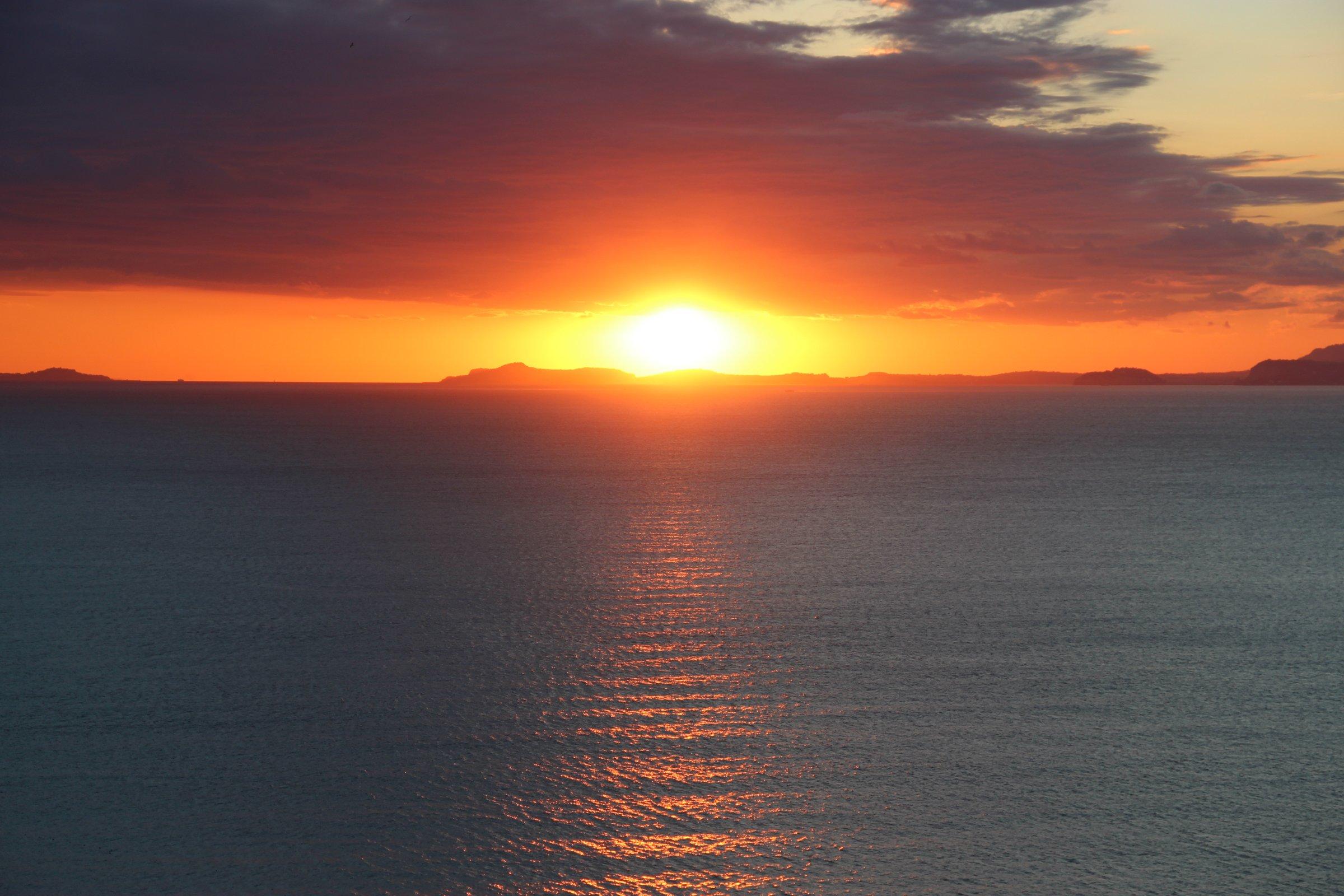Sunset Behind Island on Ocean
