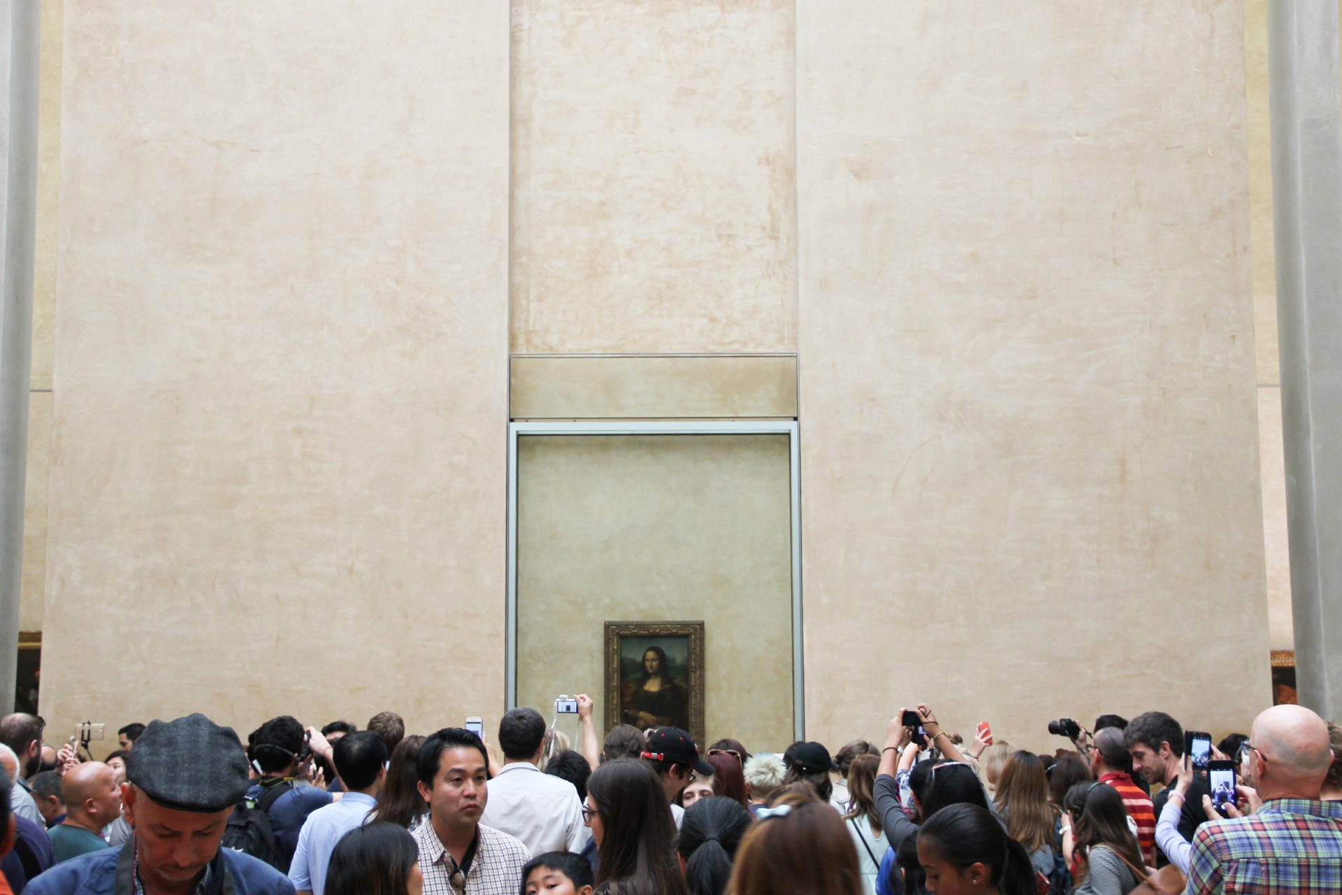 Crowd Taking Pictures Of Mona Lisa Painting