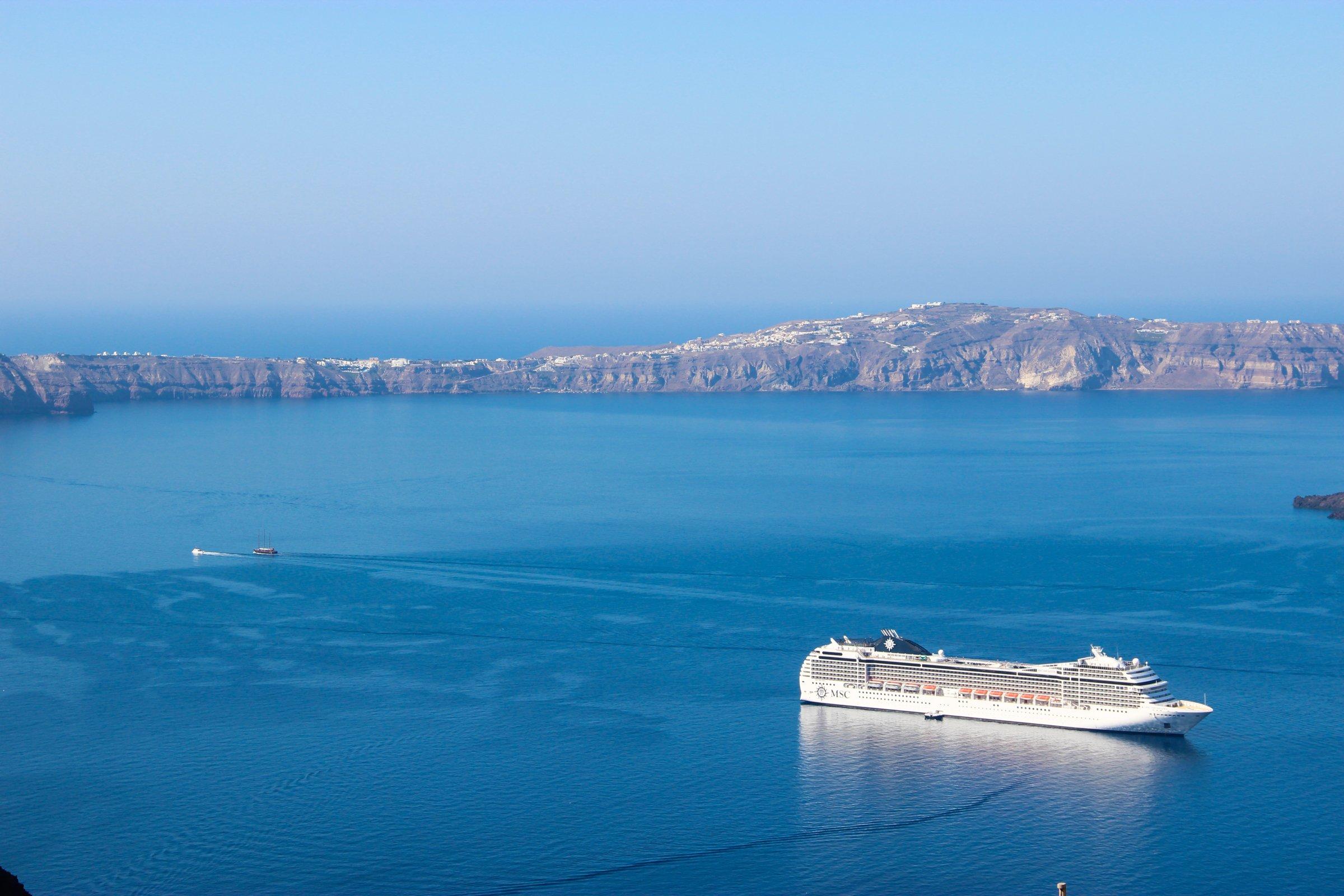 Cruise Ship In Ocean With Rock Island