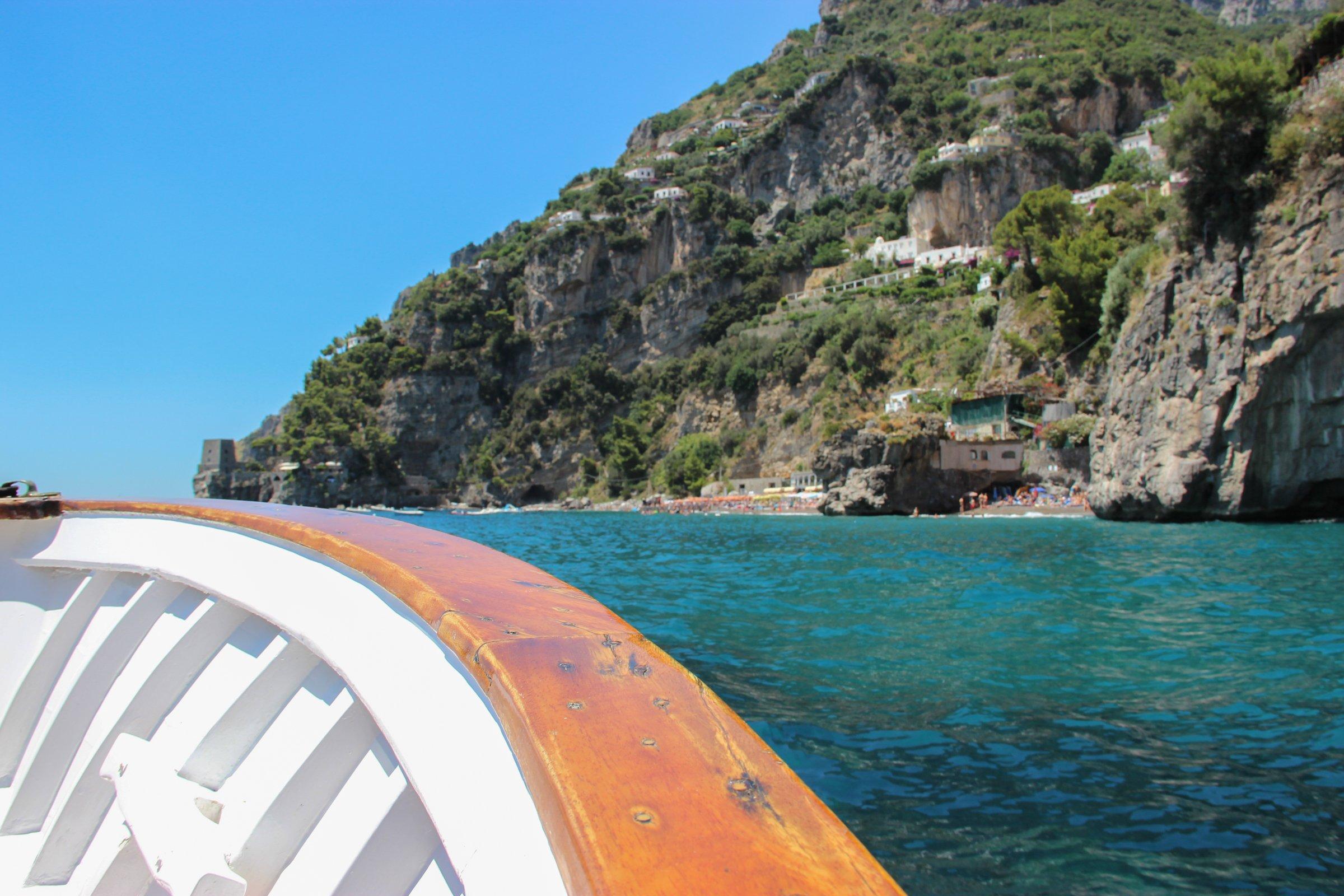 Edge Of Boat By Oceanside Cliffs
