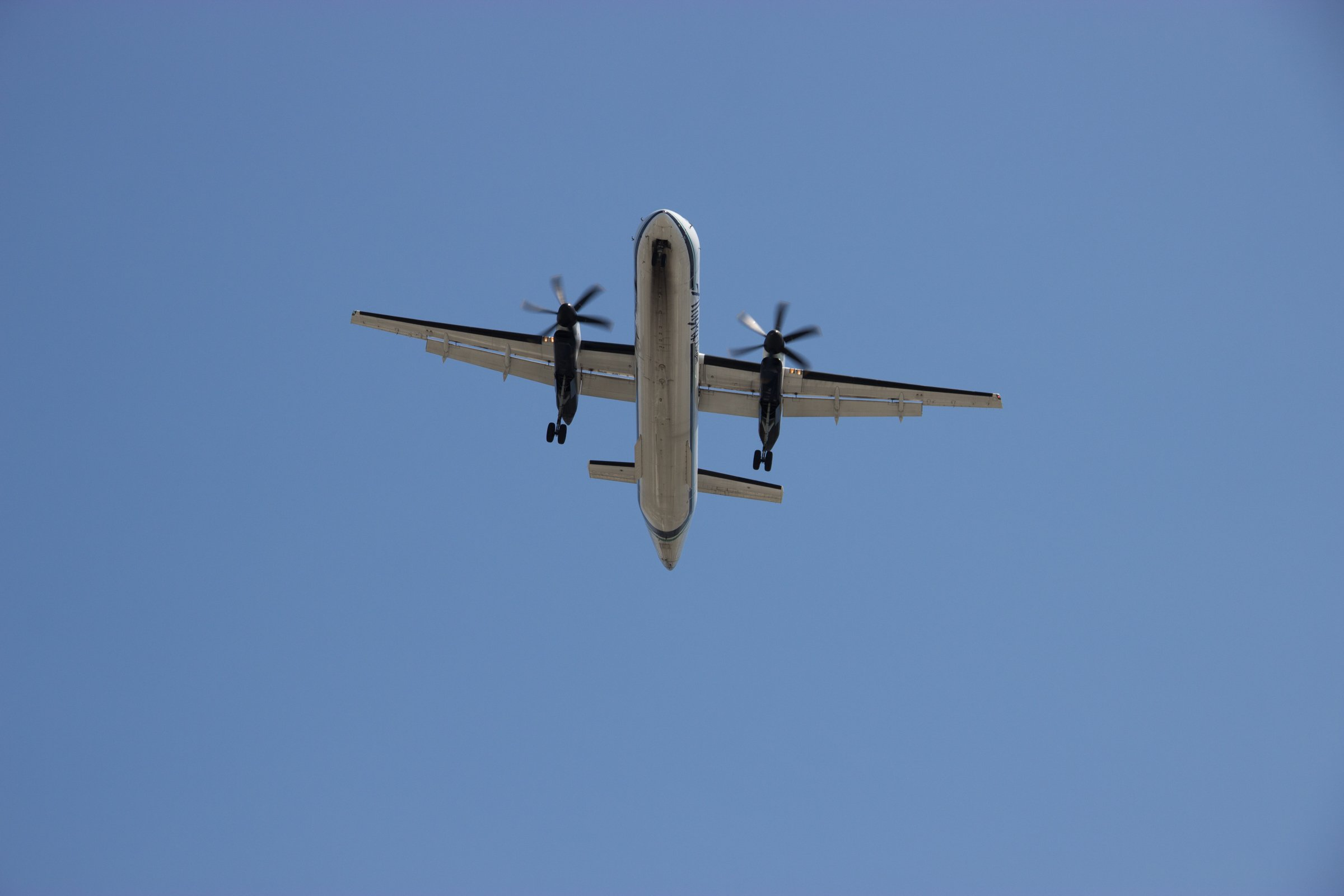 Twin Propeller Airplane Flying Overhead