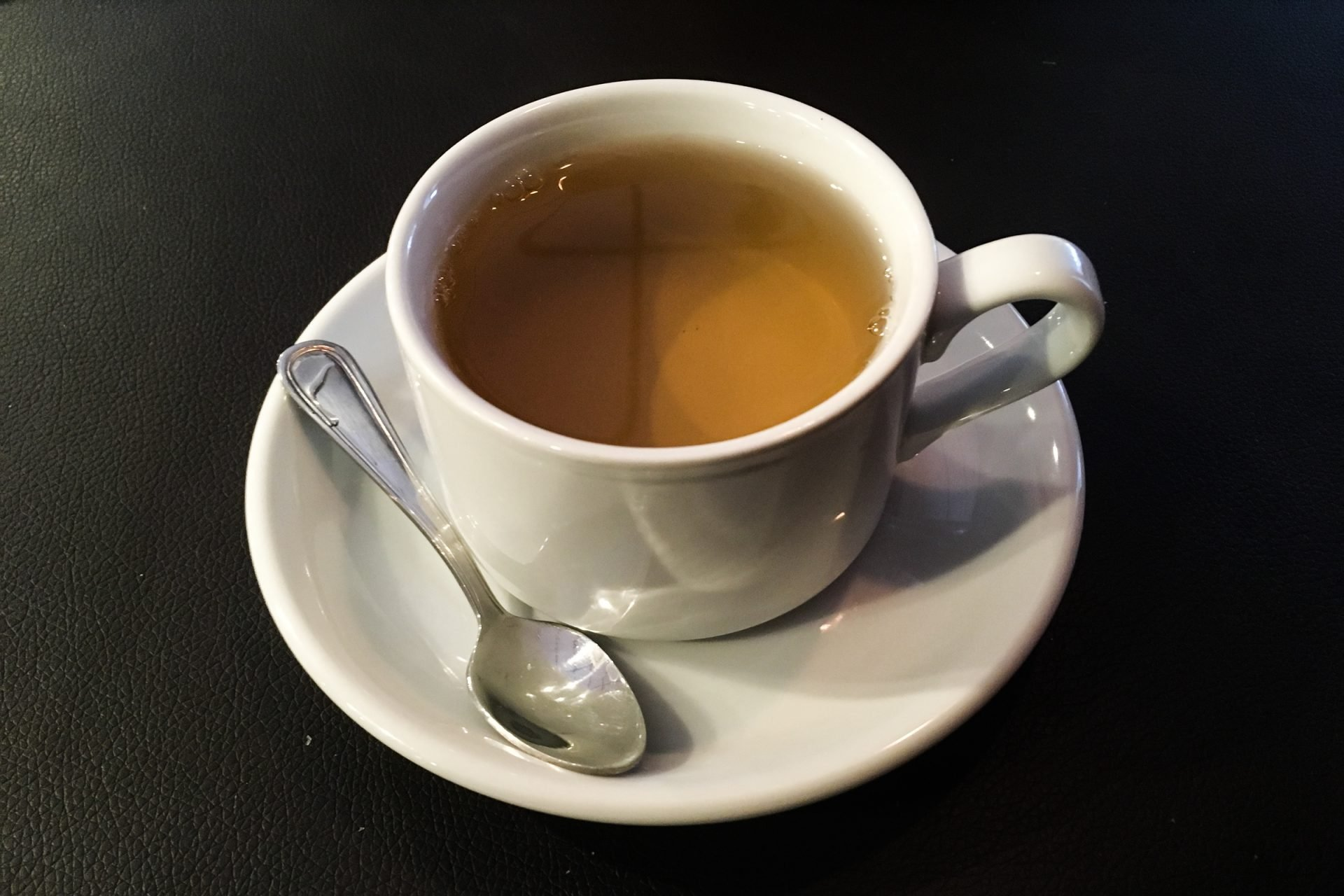 Cup Of Tea On Saucer With Spoon