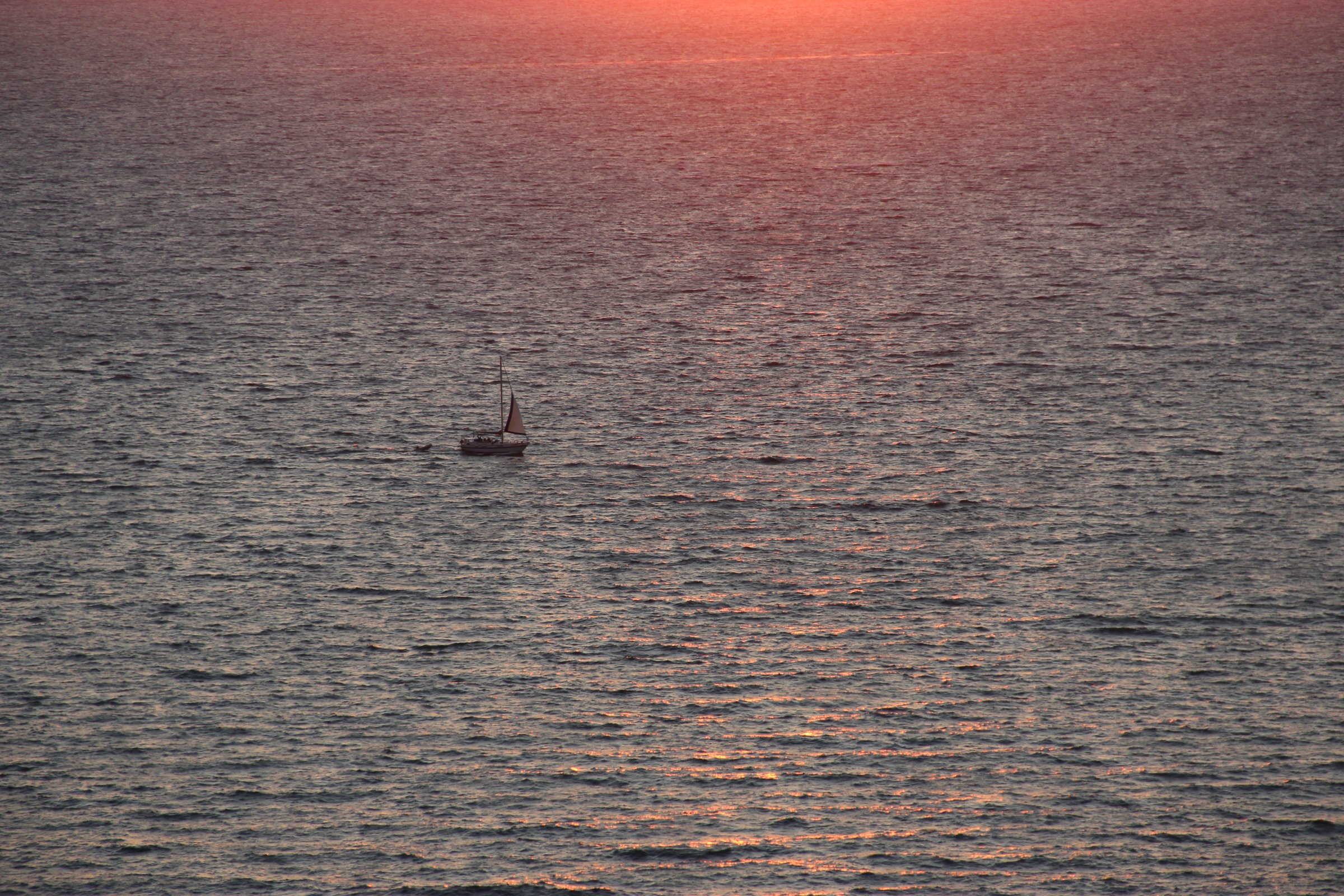 Sailboat In Middle Of Ocean