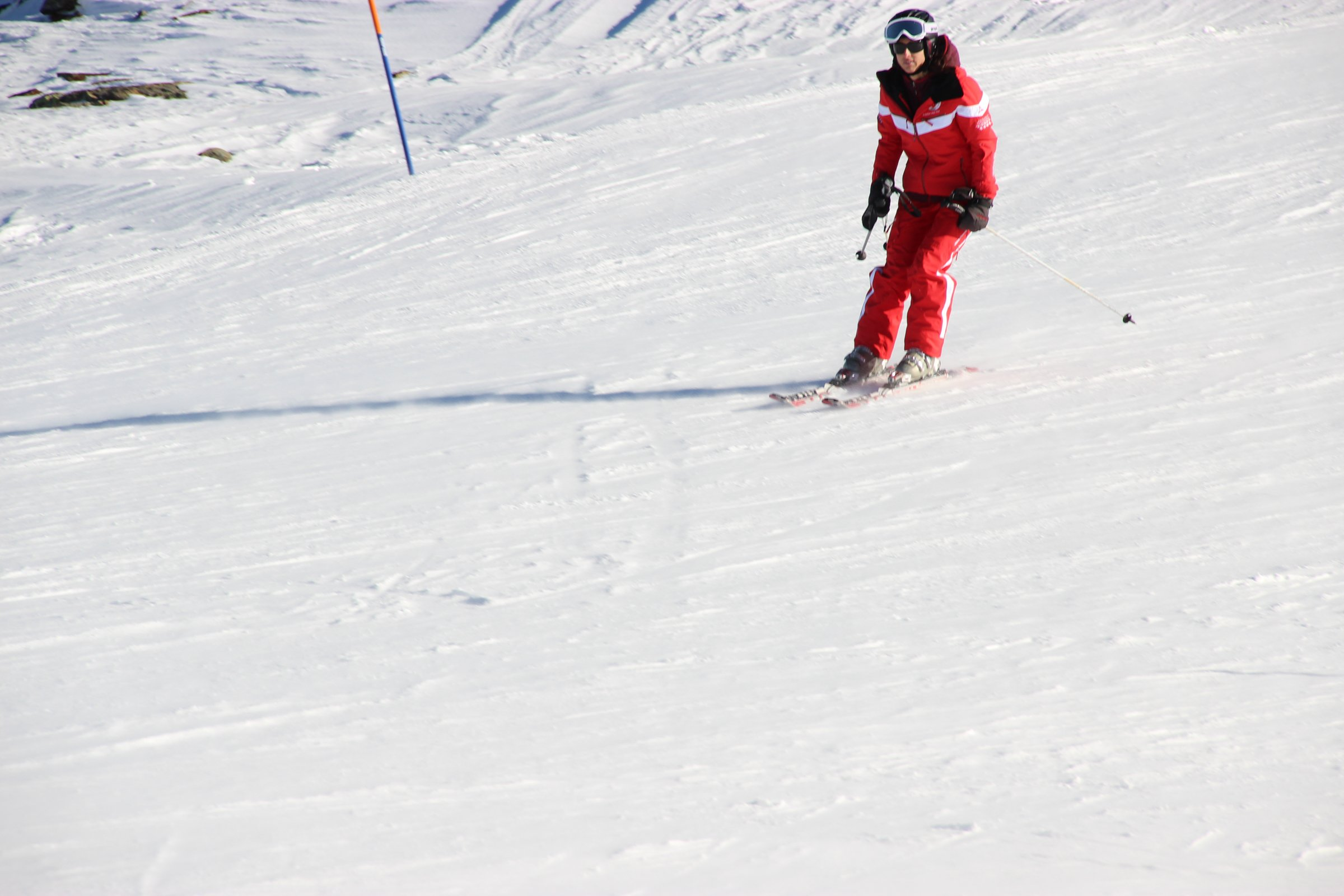 Skier Moving Downward On Snow