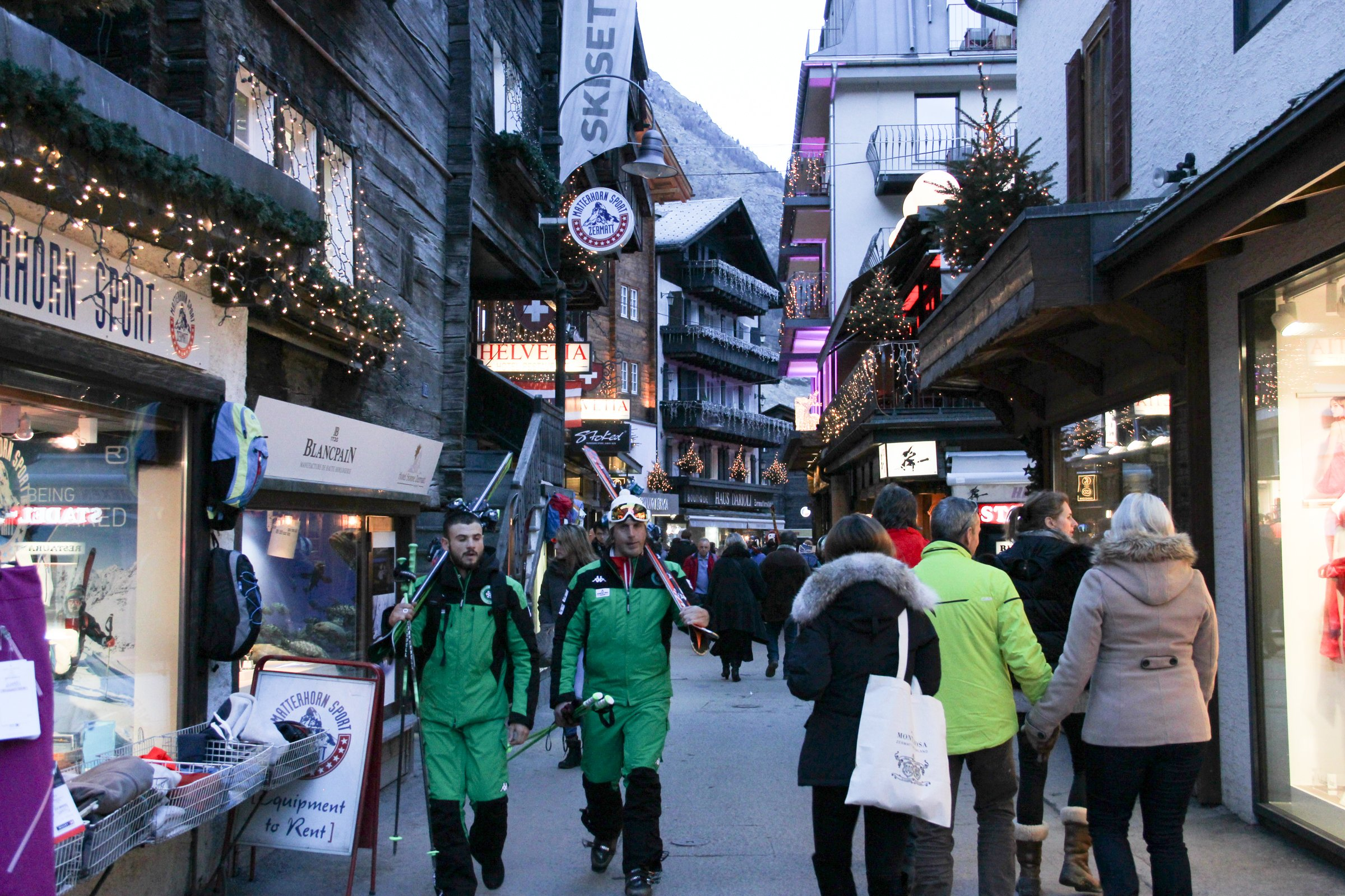 Skiers In Shopping District