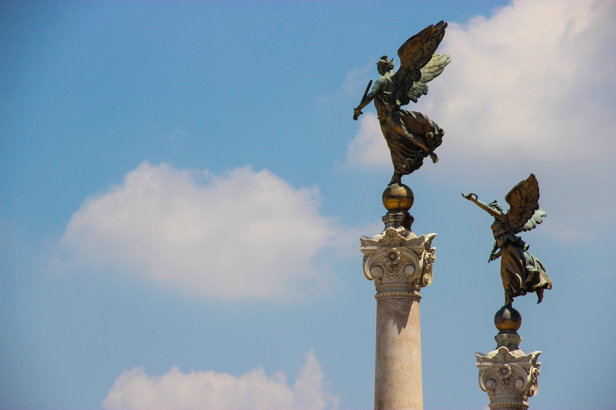 Bronze Winged Statues On Pillars