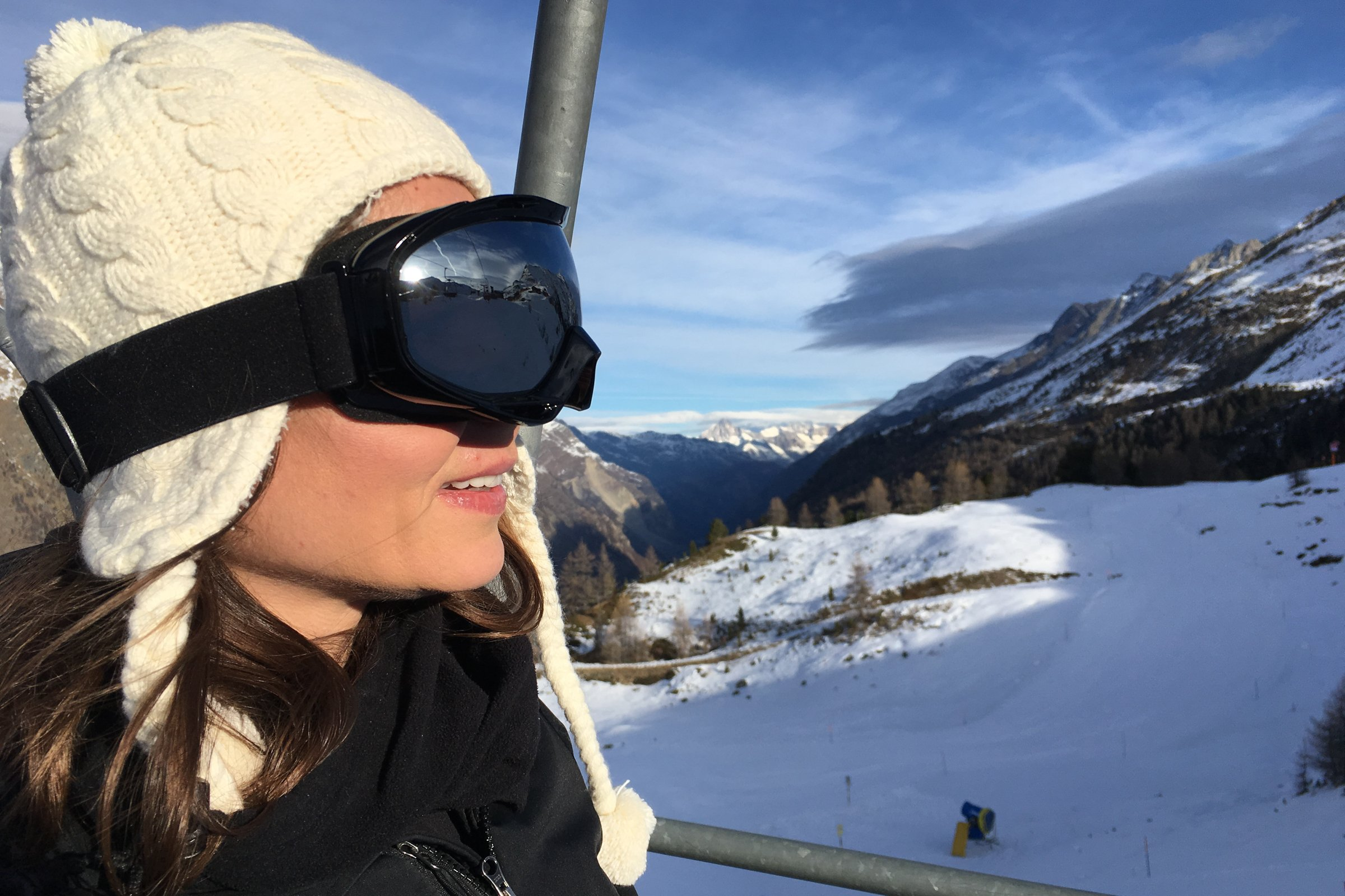 Woman With Goggles In Mountains