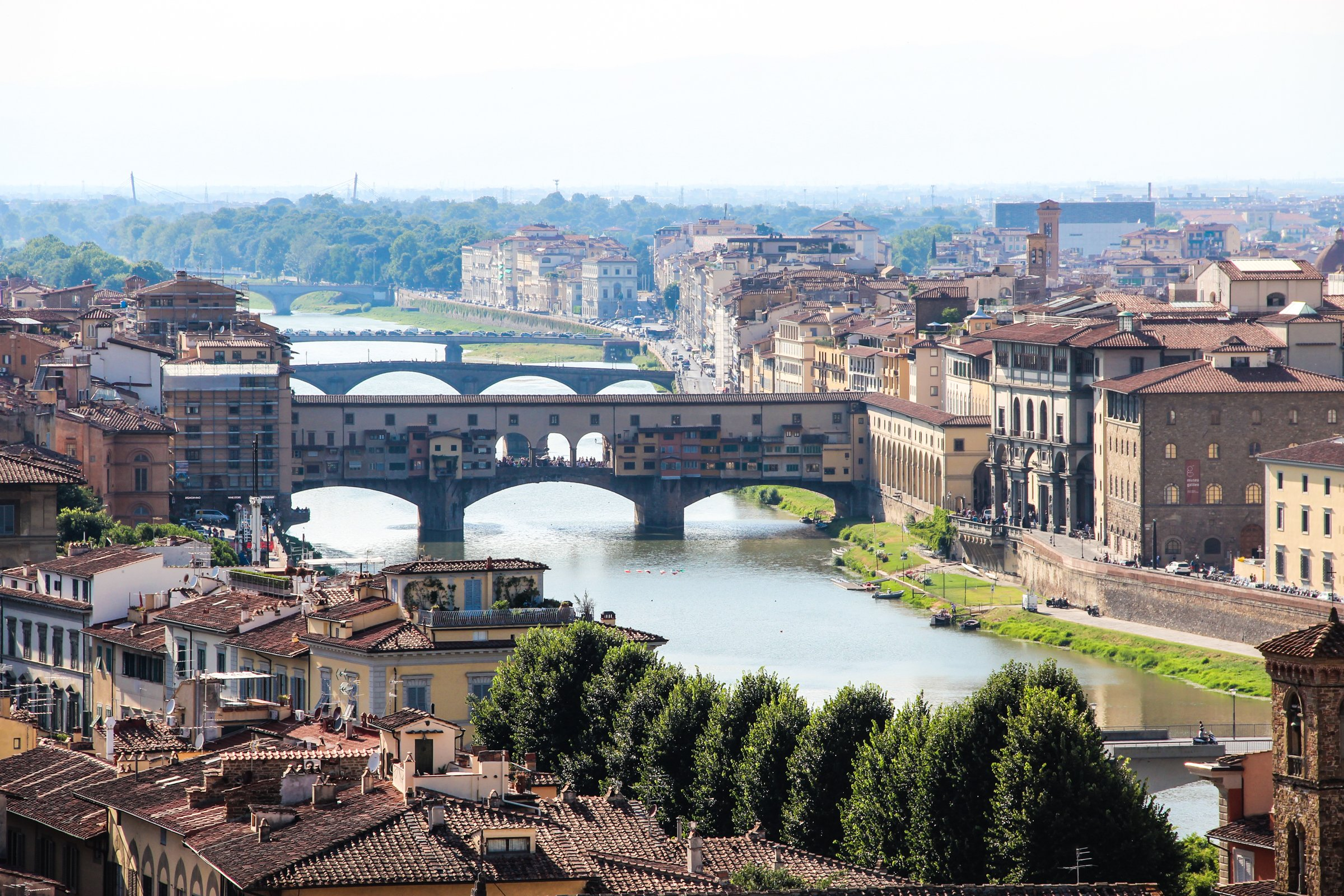 Buildings On Bridge Over River