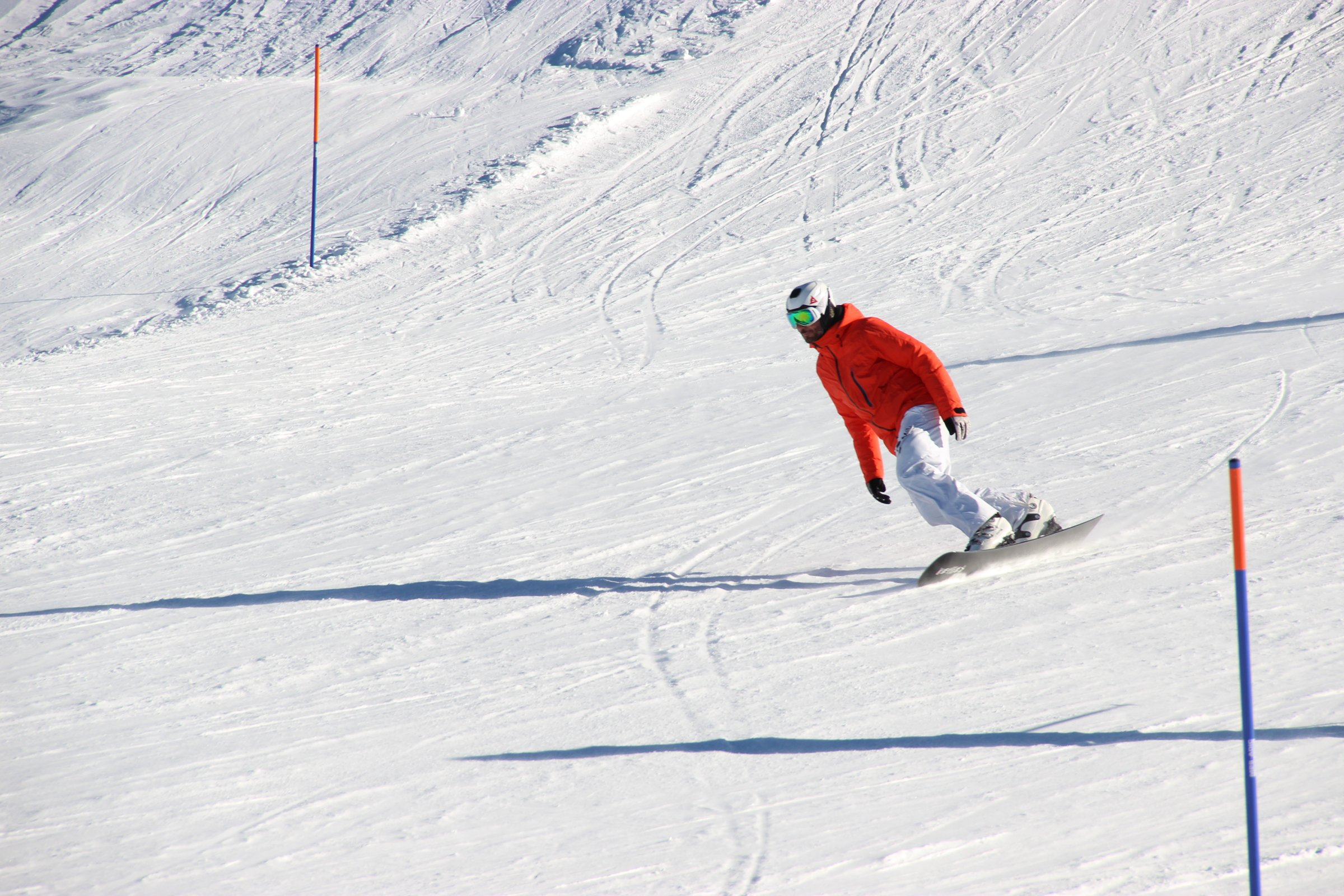Skier On Snowboard Down Slope