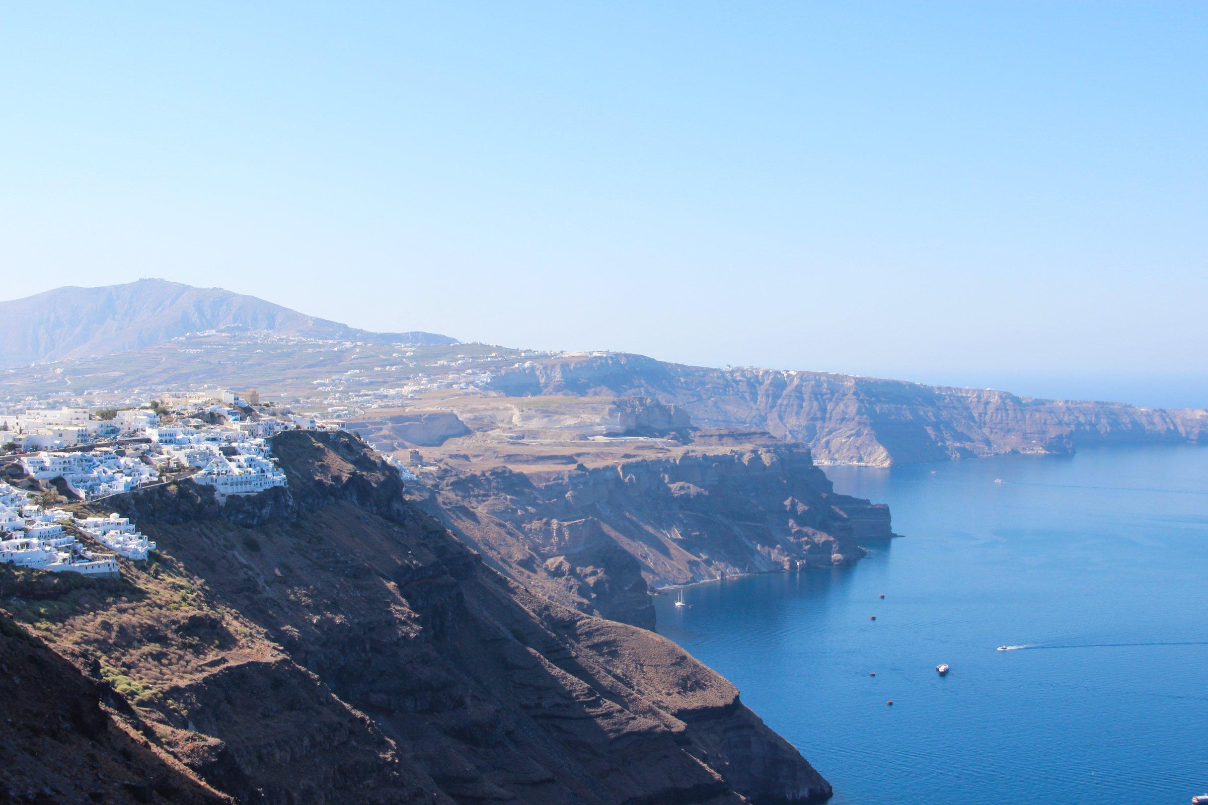 Buildings On Mountain Cliffs Near Water