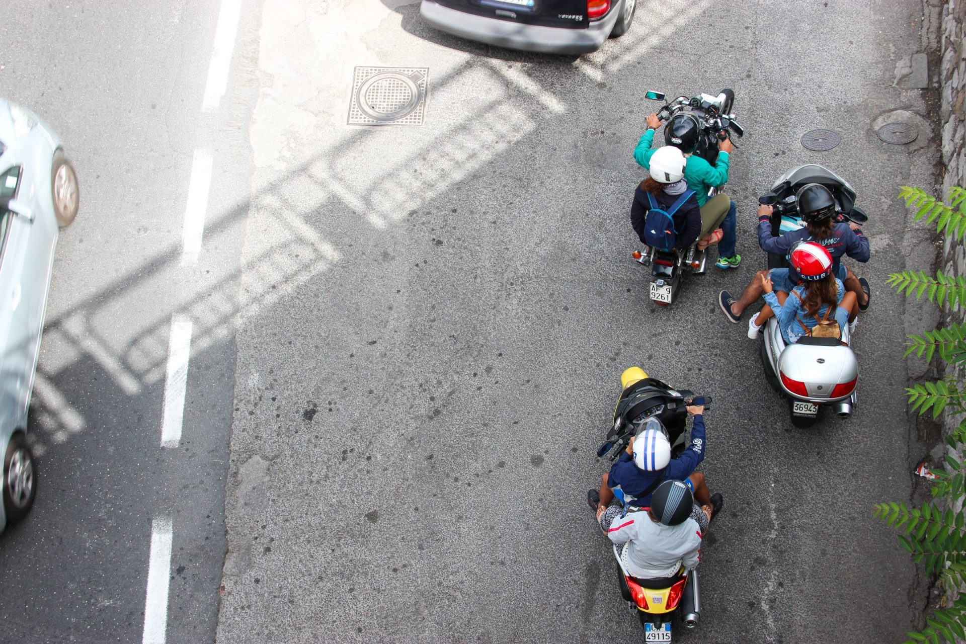 People On Motorcycles Beside Road
