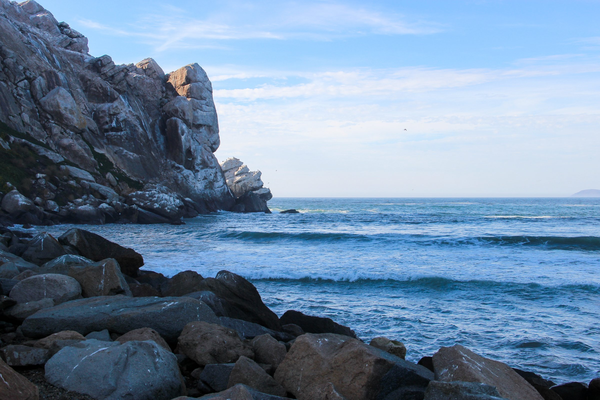 Rocky Cliff On Water