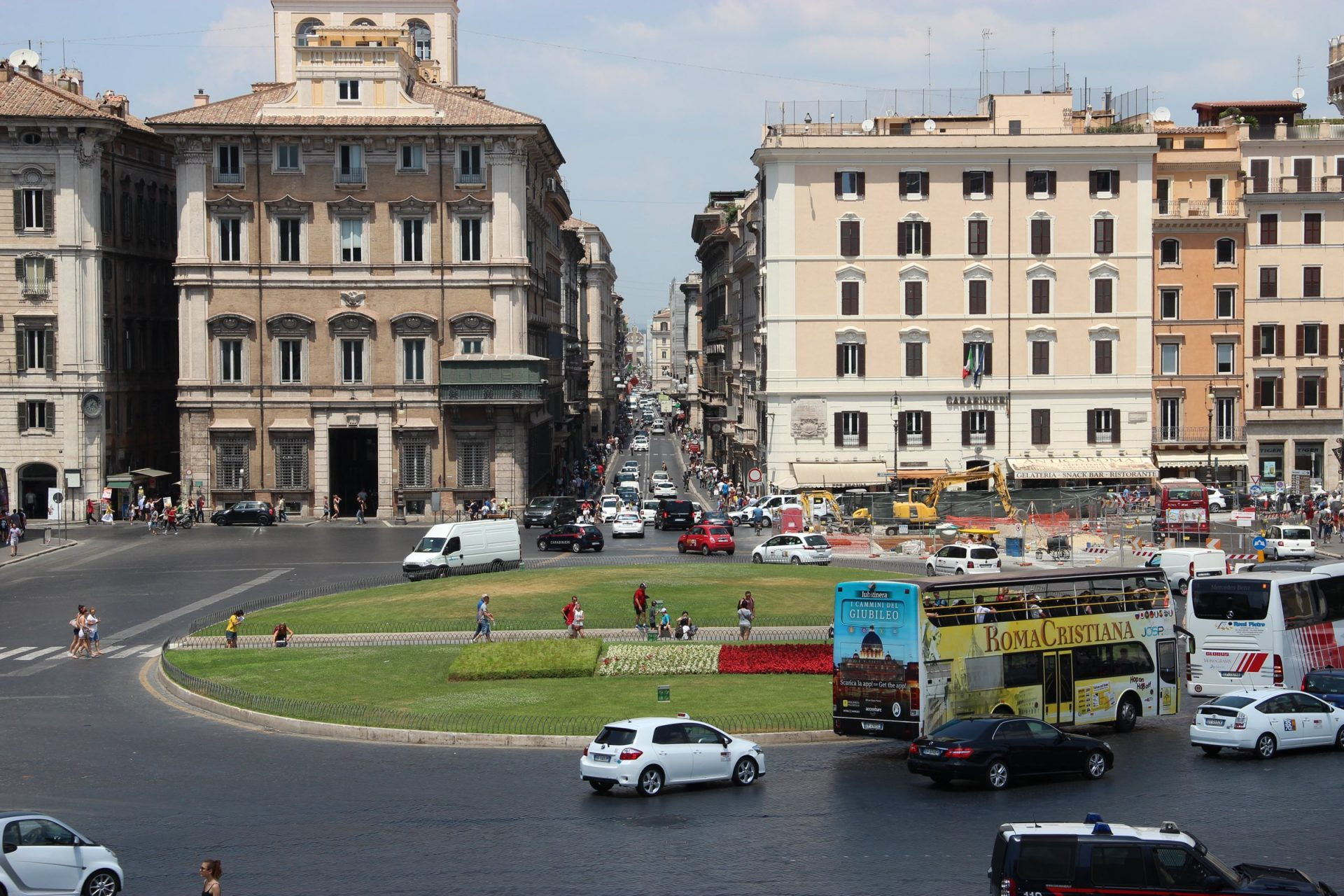 Traffic And Buildings At Roundabout In Rome