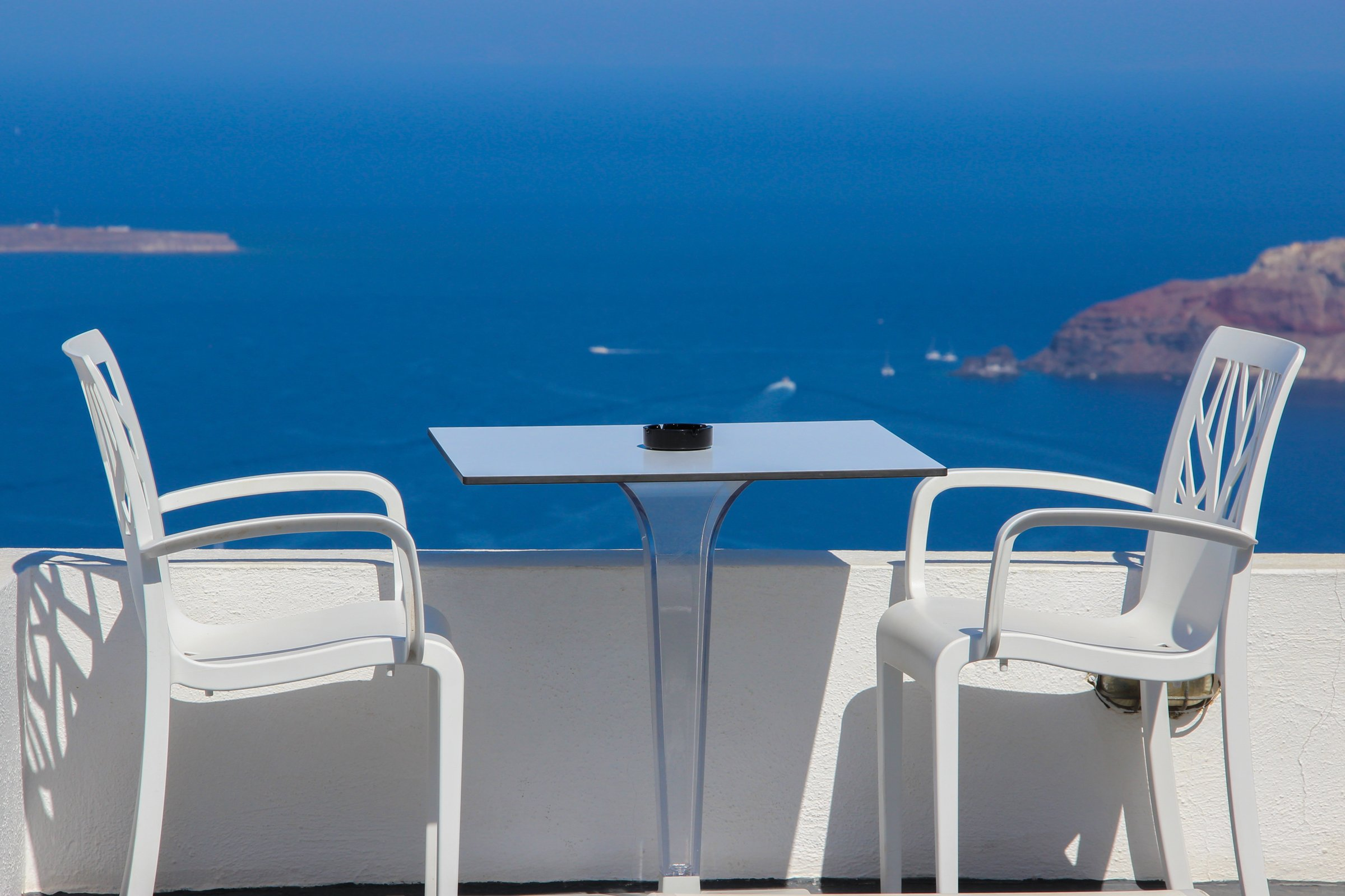 Two Chairs And Table On Terrace Near Sea