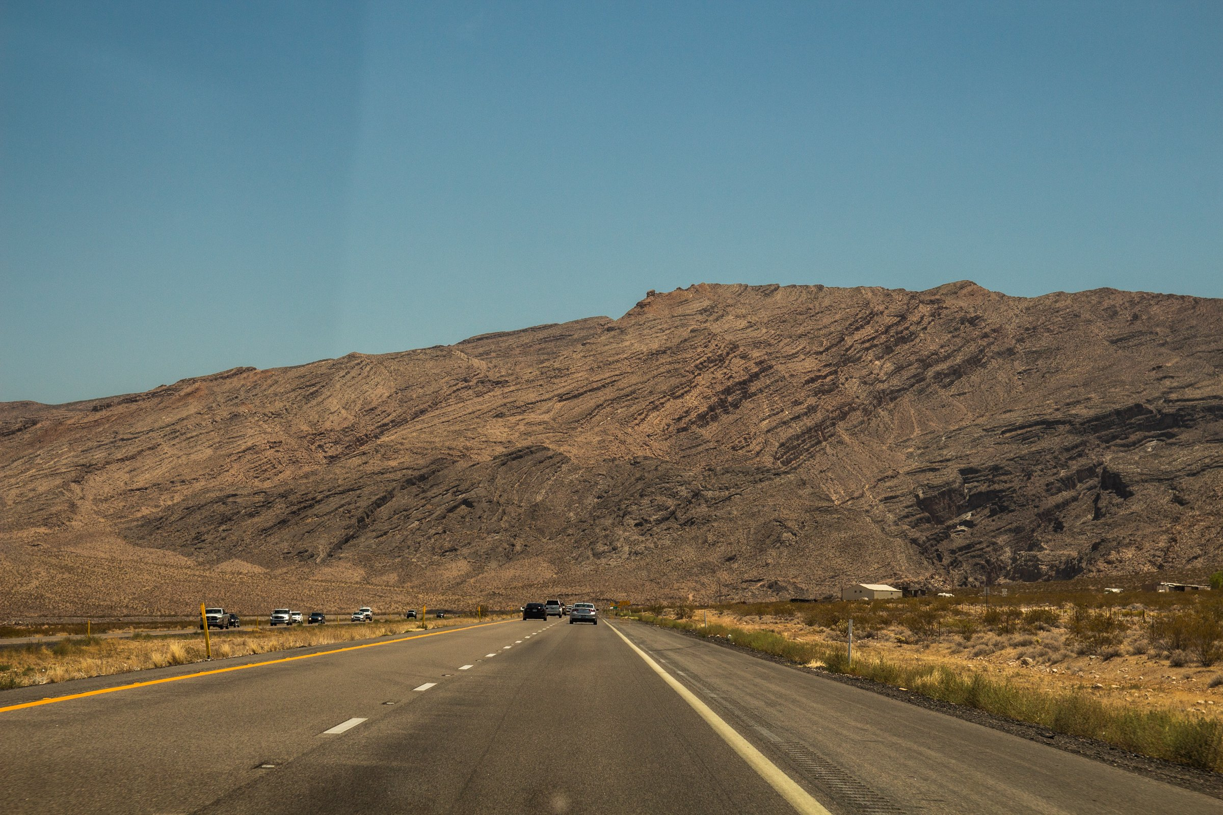 Cars In Desert Expressway Heading To Mountains