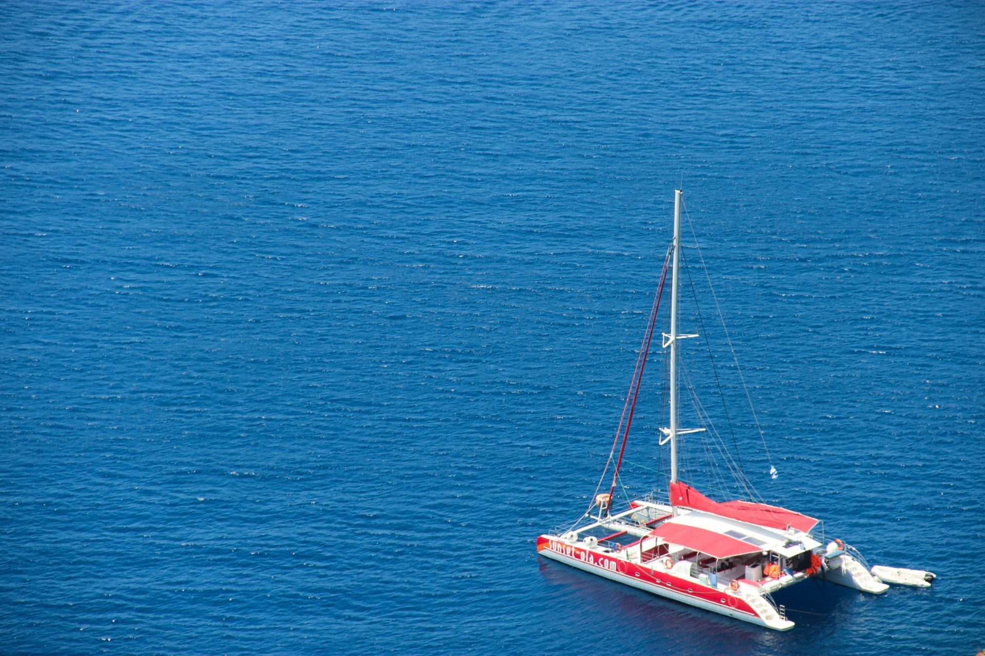 Catamaran Sailboat On Water